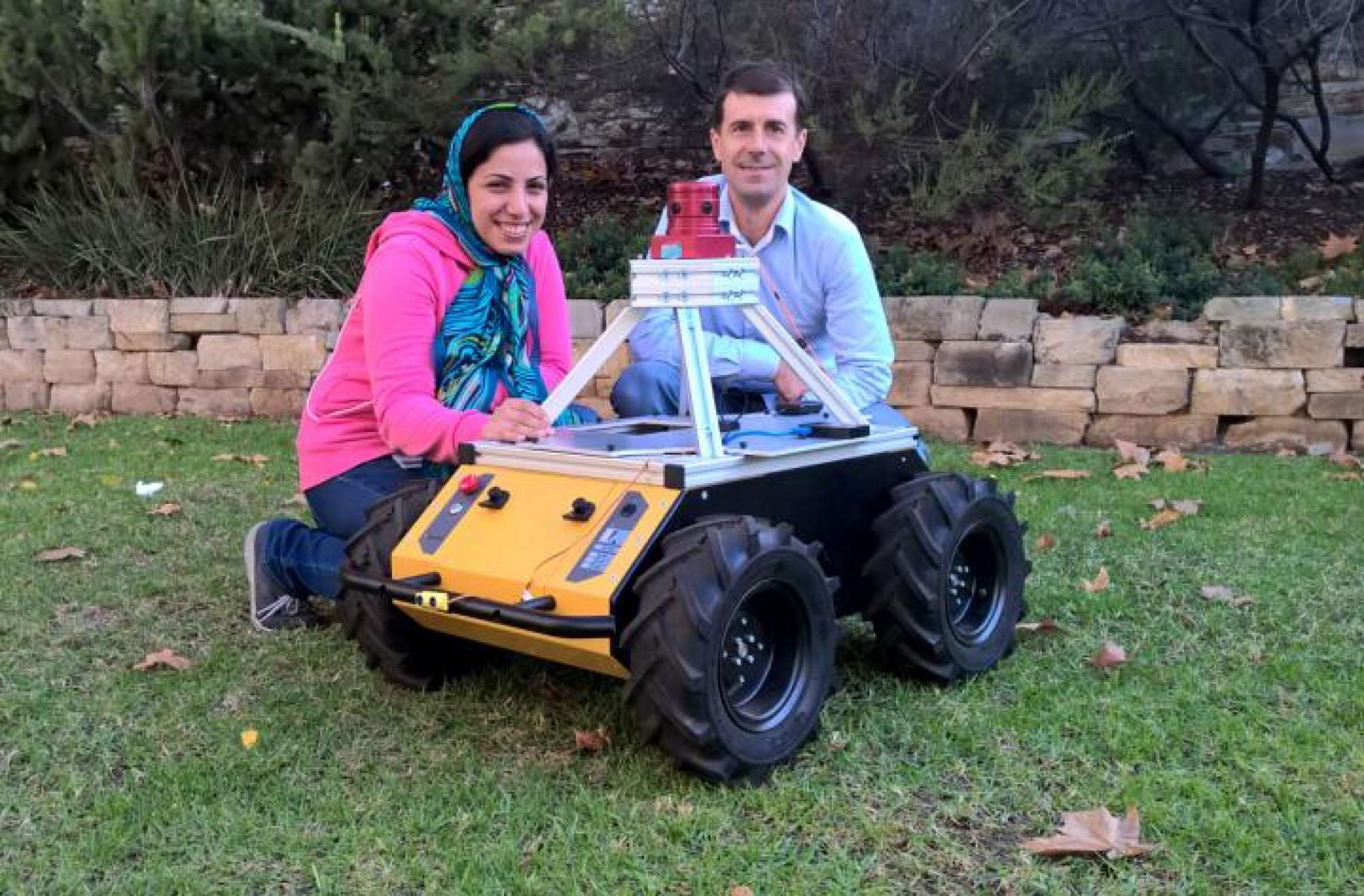 The University of Adelaide  Scientists Zahra Bagheri and Benjamin Cazzolato, and robot.