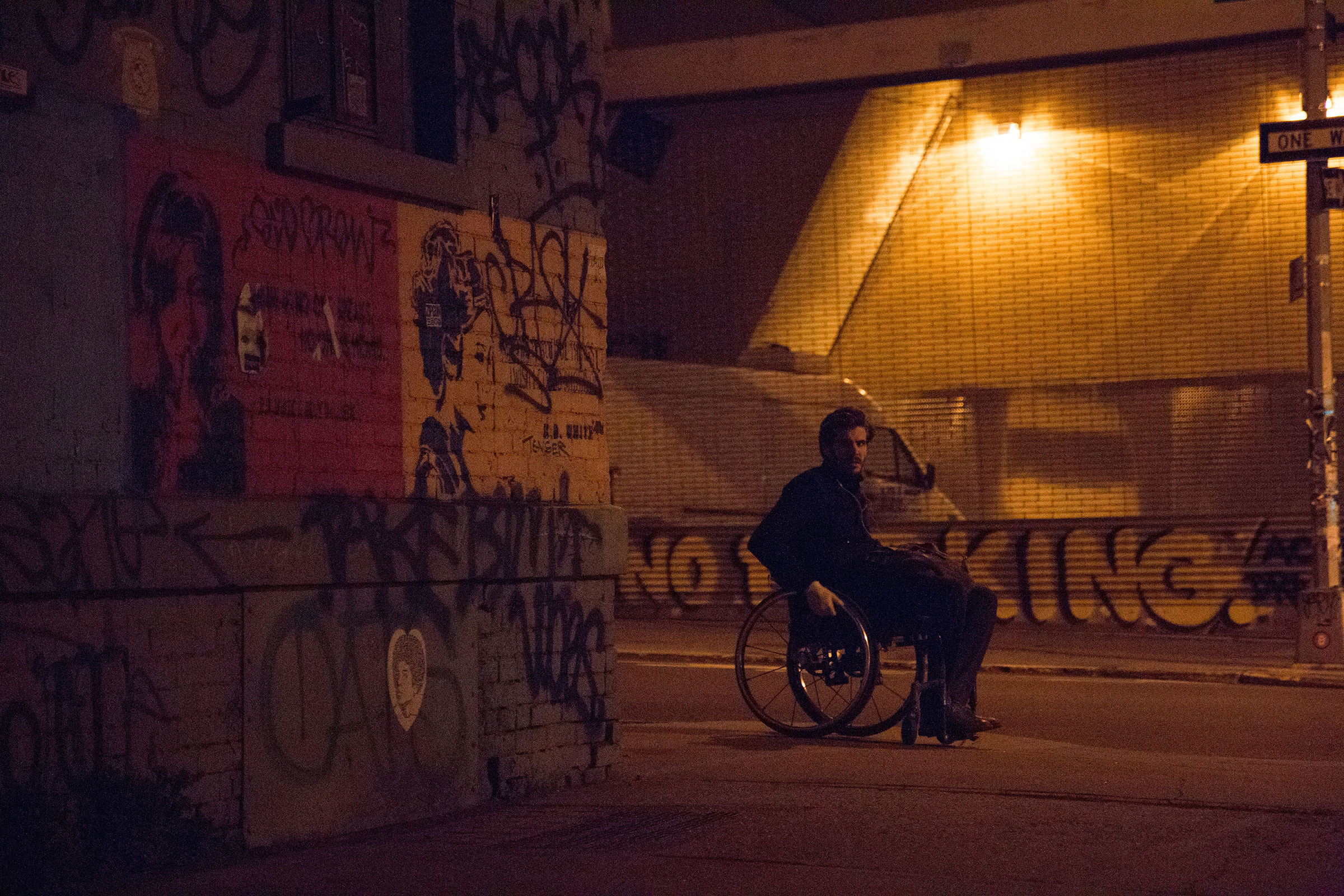 B.D. White severed his spine during a pole-vaulting accident as a teen and can't use his legs, but he doesn't let his disability hinder his passion for street art. Under the cover of darkness, the 31-year-old artist goes to the areas of Brooklyn, NY, where he's planned to put up his stencils and wheat paste posters.