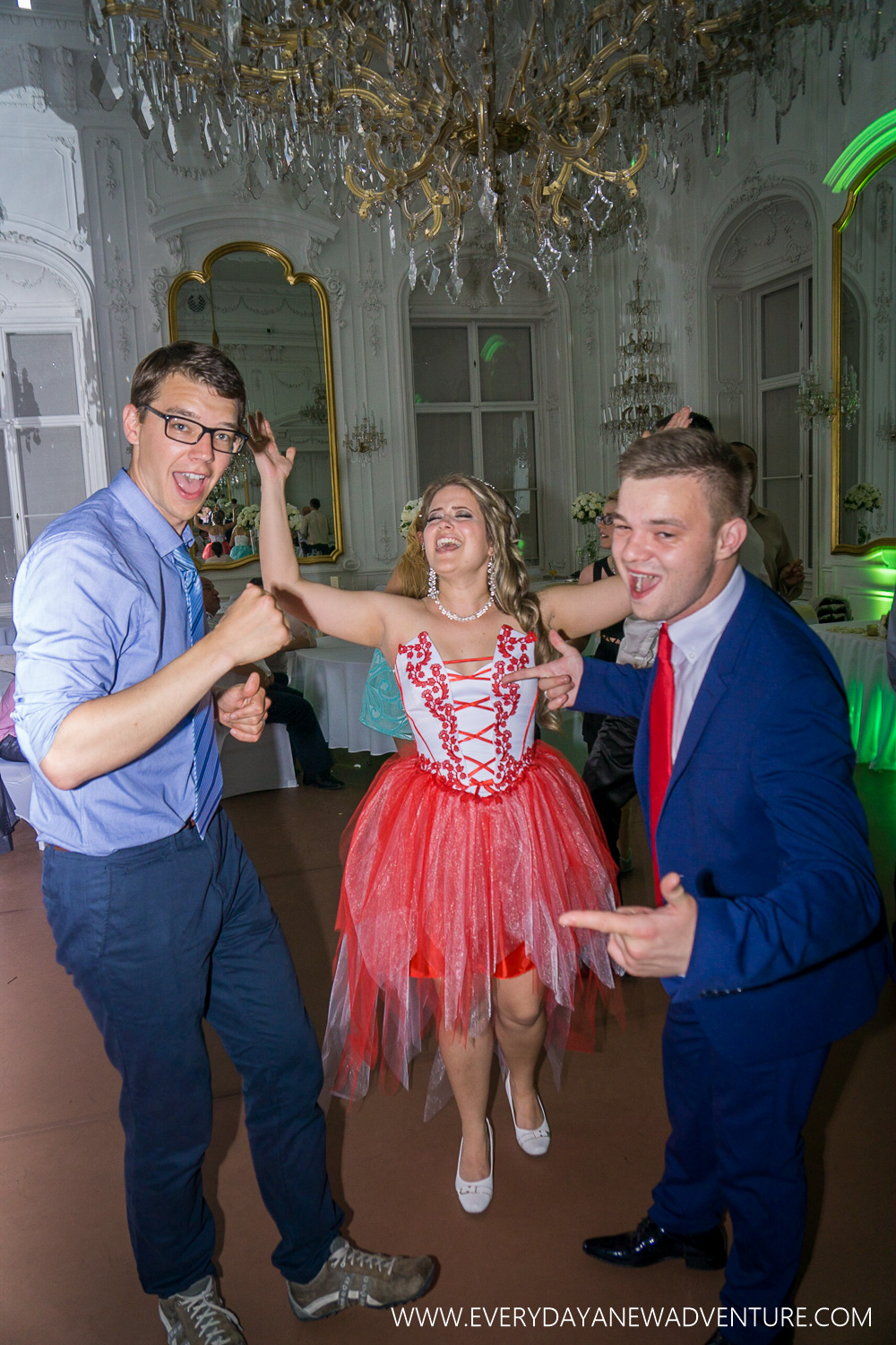 Jake dancing the night away with the bride and goom in their new outfits