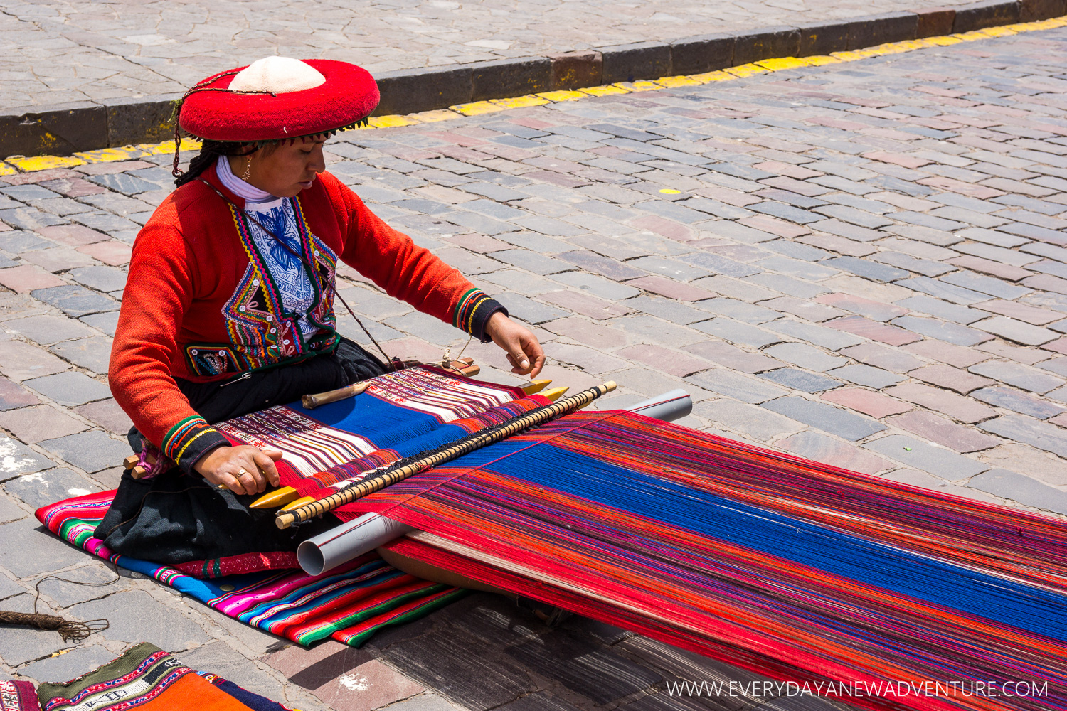 One of the many skilled weavers working in the main square.