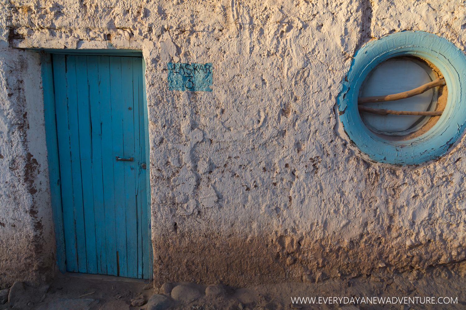 Mud walls and a window made out of a Michelin tire -a standard home in San Pedro de Atacama.