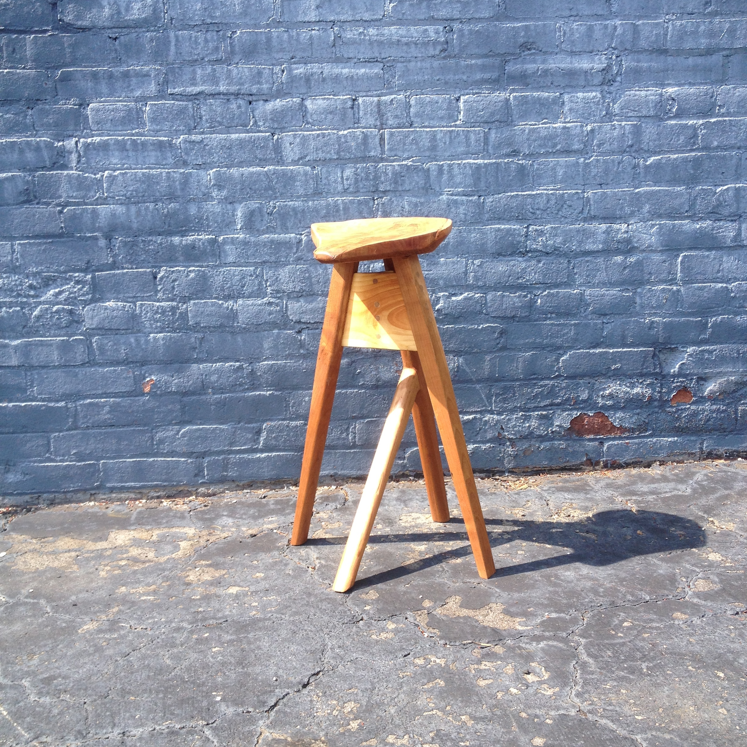 A weird stool I made just for shits. It's basically designed around my lack of wood at the time. The seat is a weird crotchy part of a log a friend gave me. I would like one day to make it again but... you know... better.