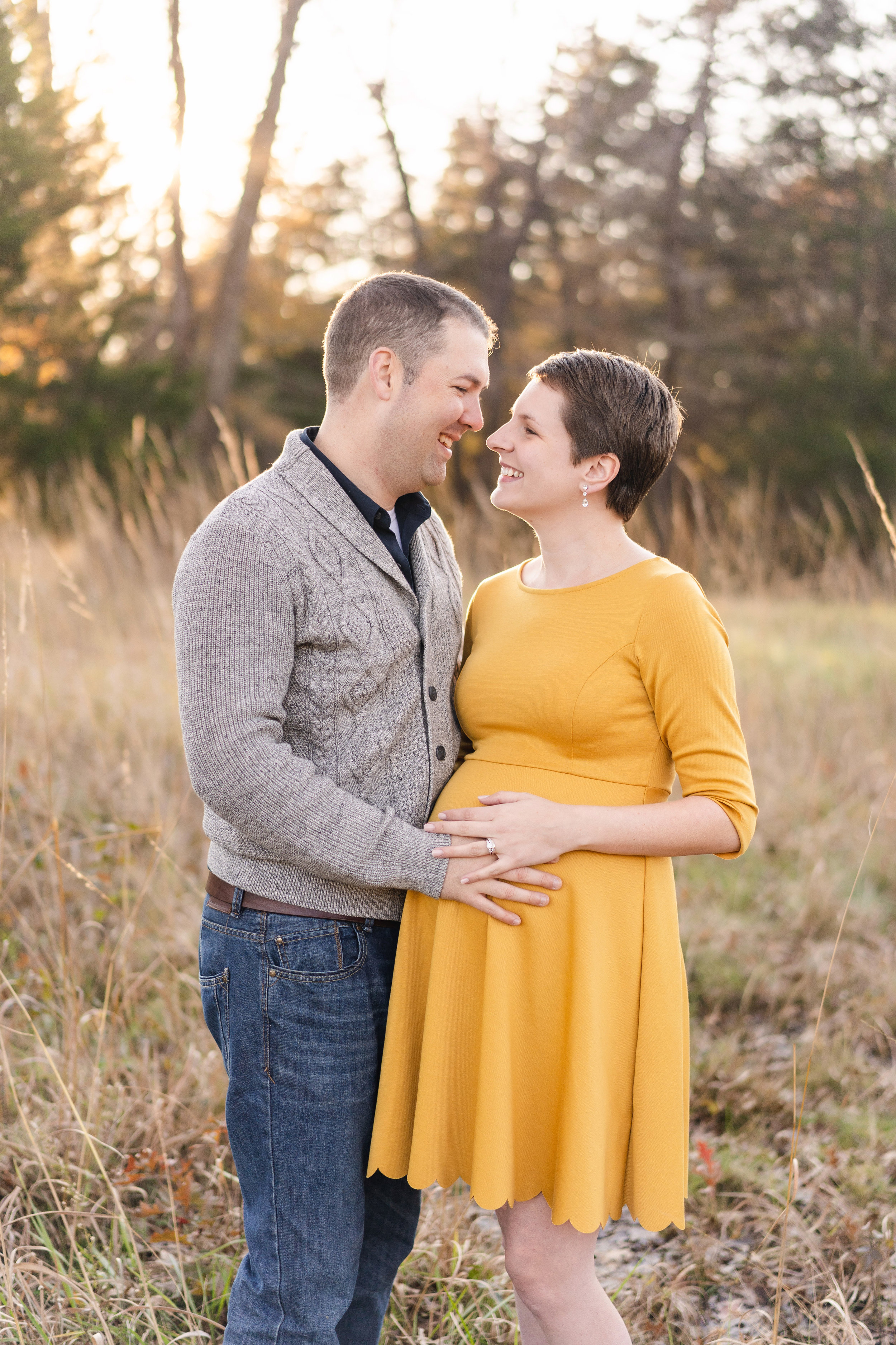 Sweet moment between Mom and Dad during their maternity session in northern virginia
