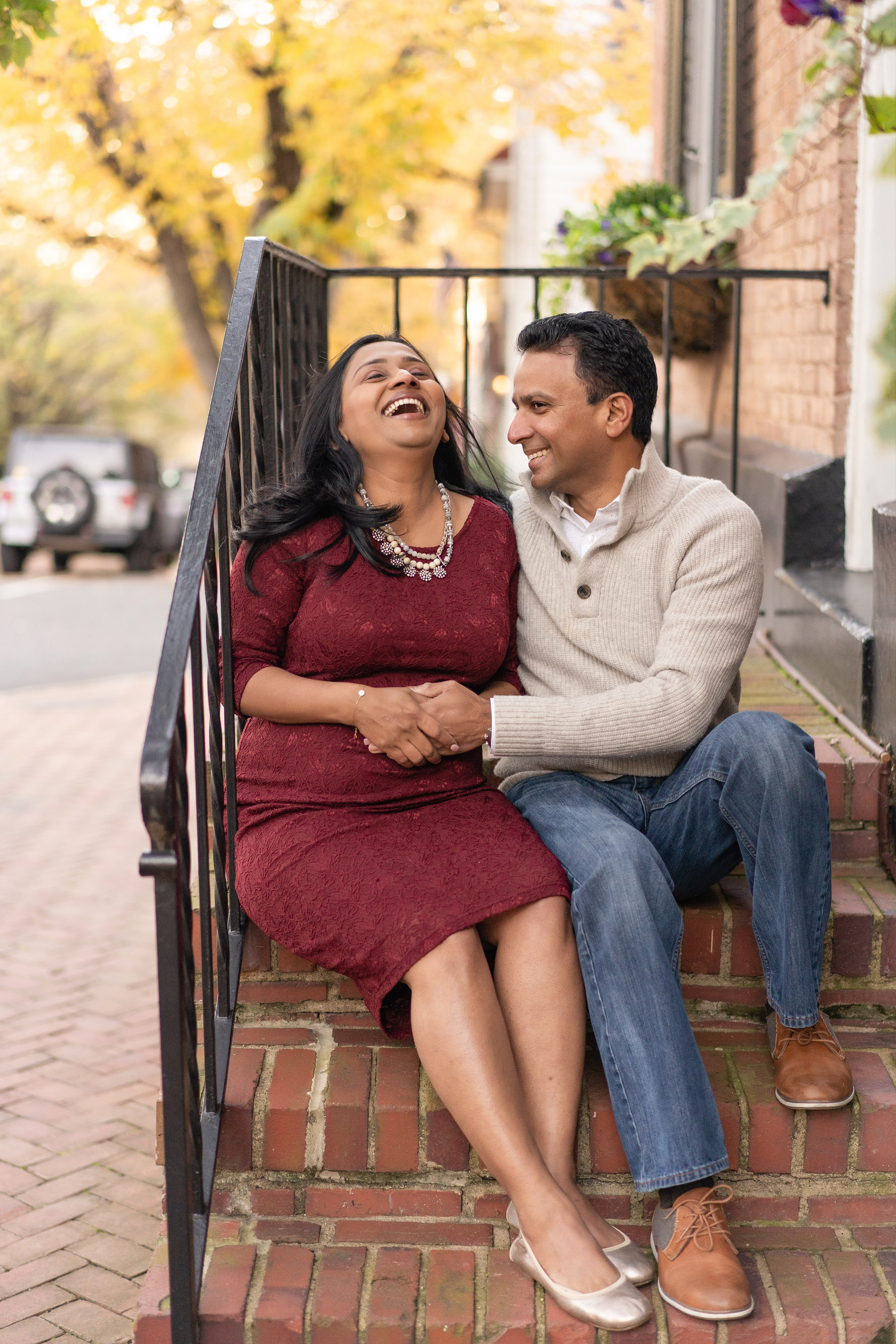 giggles are guaranteed during a maternity session with the best photographer near me, Katy Hayes Photography