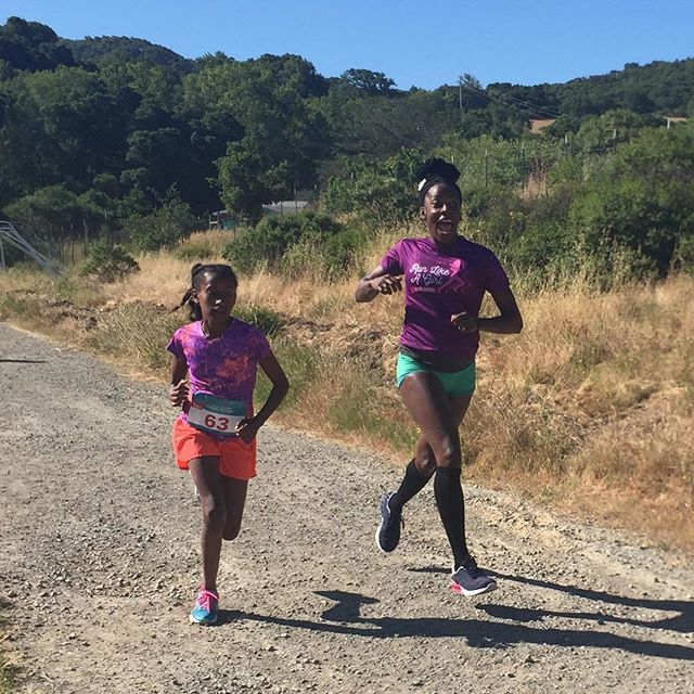 I don't think you can tell I had fun running the Bank of Marin #RunLikeAGirl 1 mile race today hosted by @titaniumracinginc ❤️ I'm running with the girls winner, Jasmine Hall, she unleashed the fiercest surges and kick of all time! Lil nugget in my belly had fun too 😝! Way to raise strong girls @sarahall3 and @ryanhall3 😍
