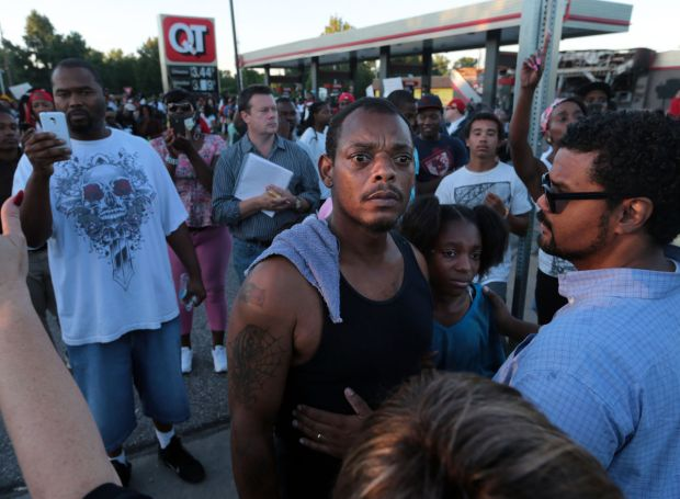 Ferguson-protesters-stand-up-for-child.jpg