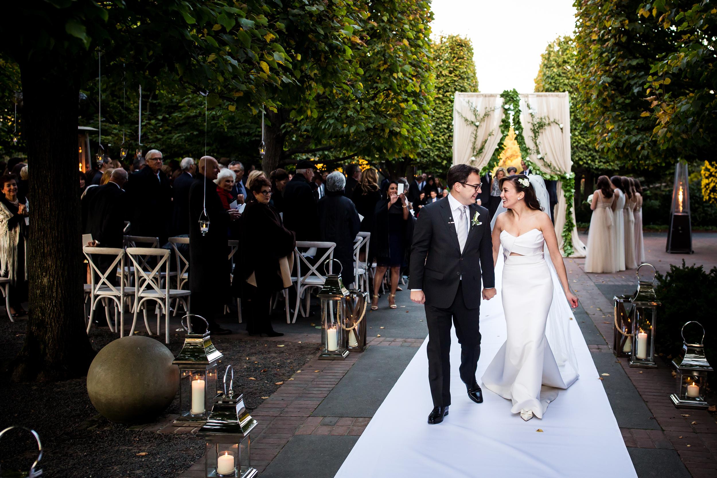 Walking down the aisle at real wedding at Chicago Botanic Garden
