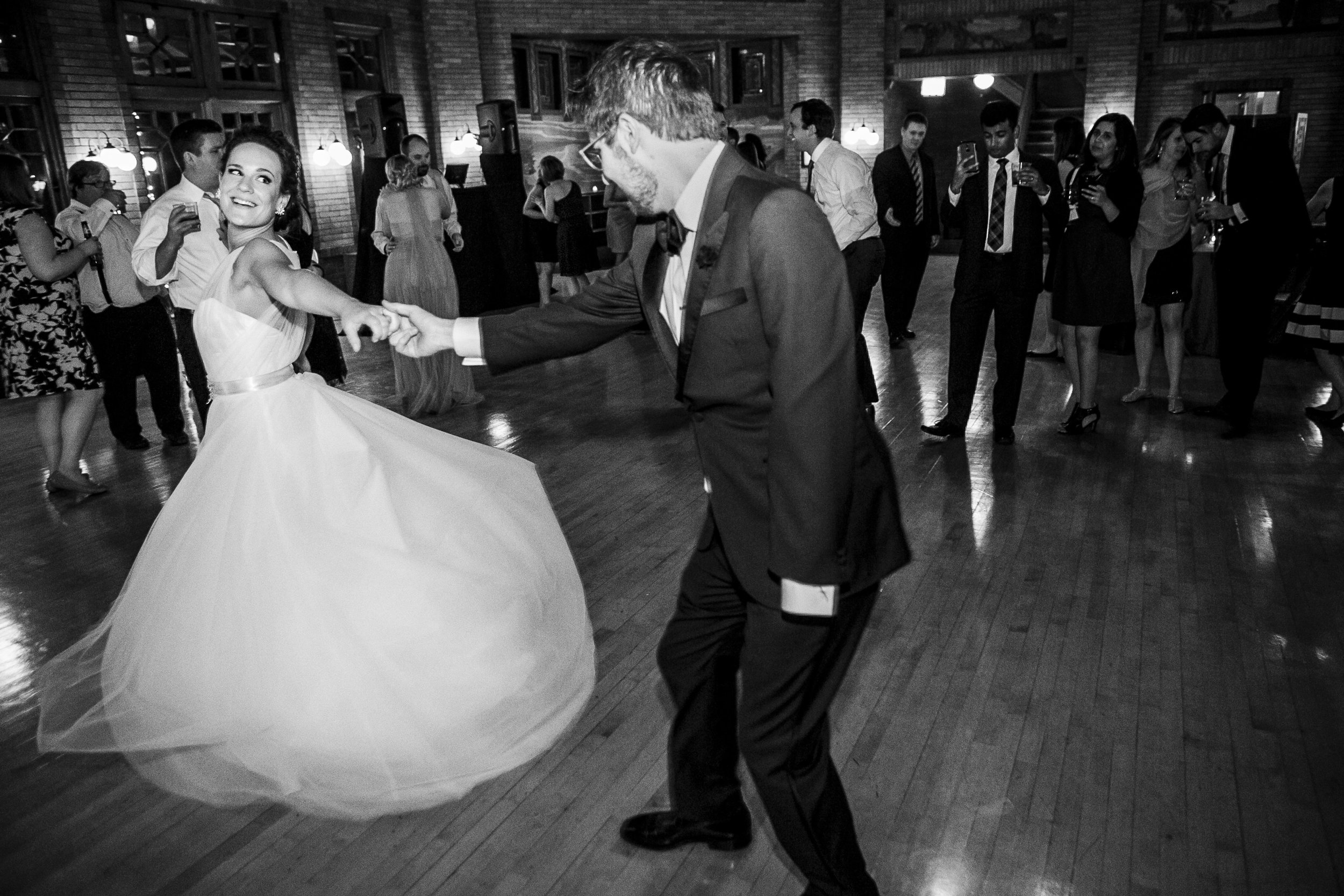 Dancing couple spinning during their first dance
