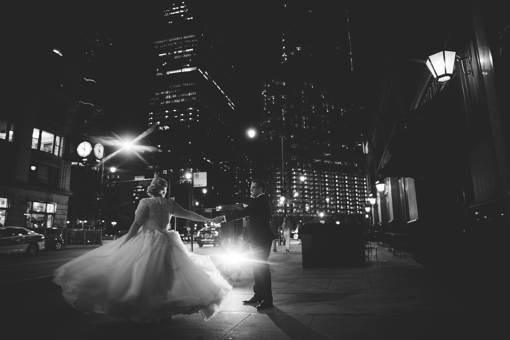 Couple twirling on the streets of Chicago