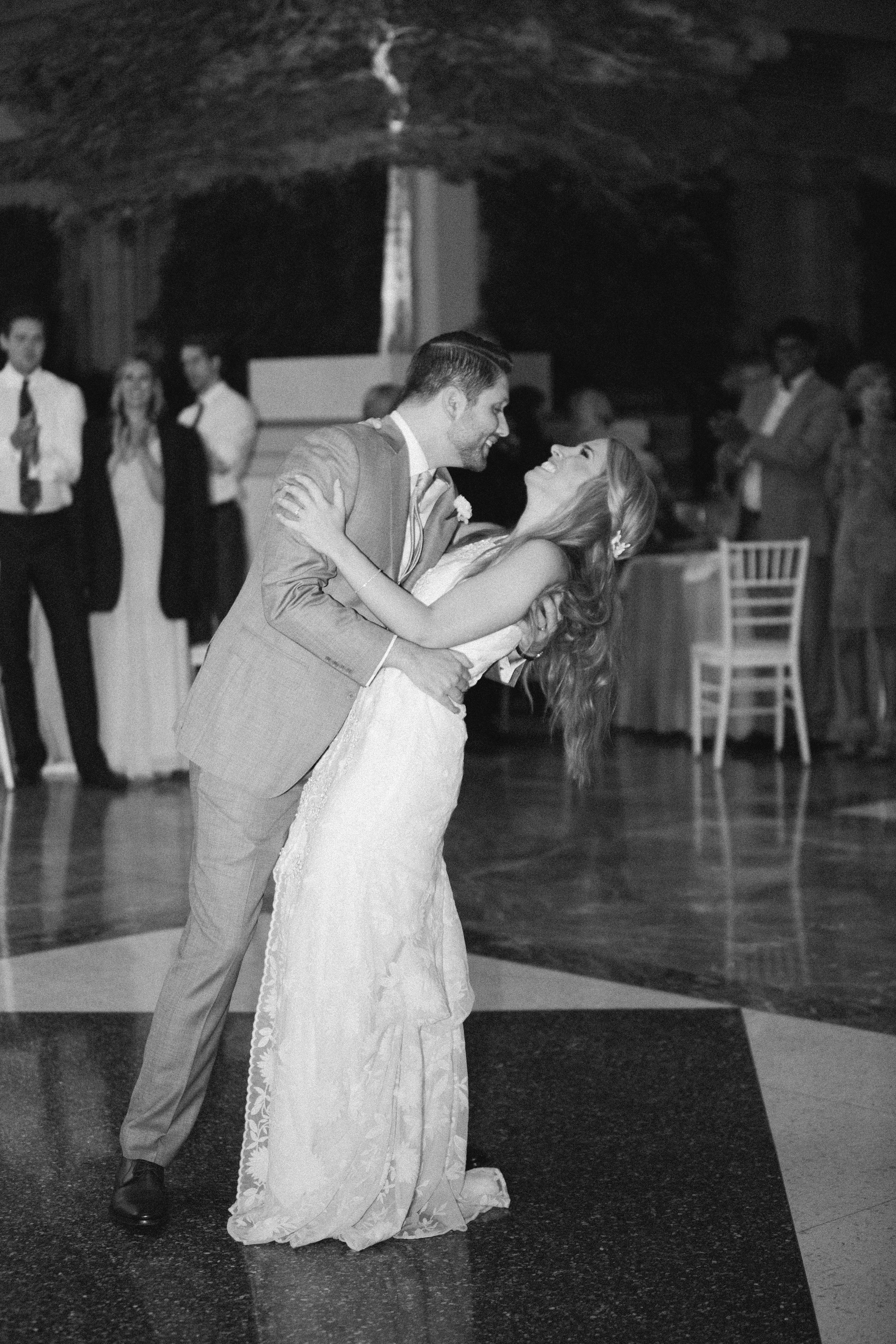 Couple dipping during their first dance at their wedding