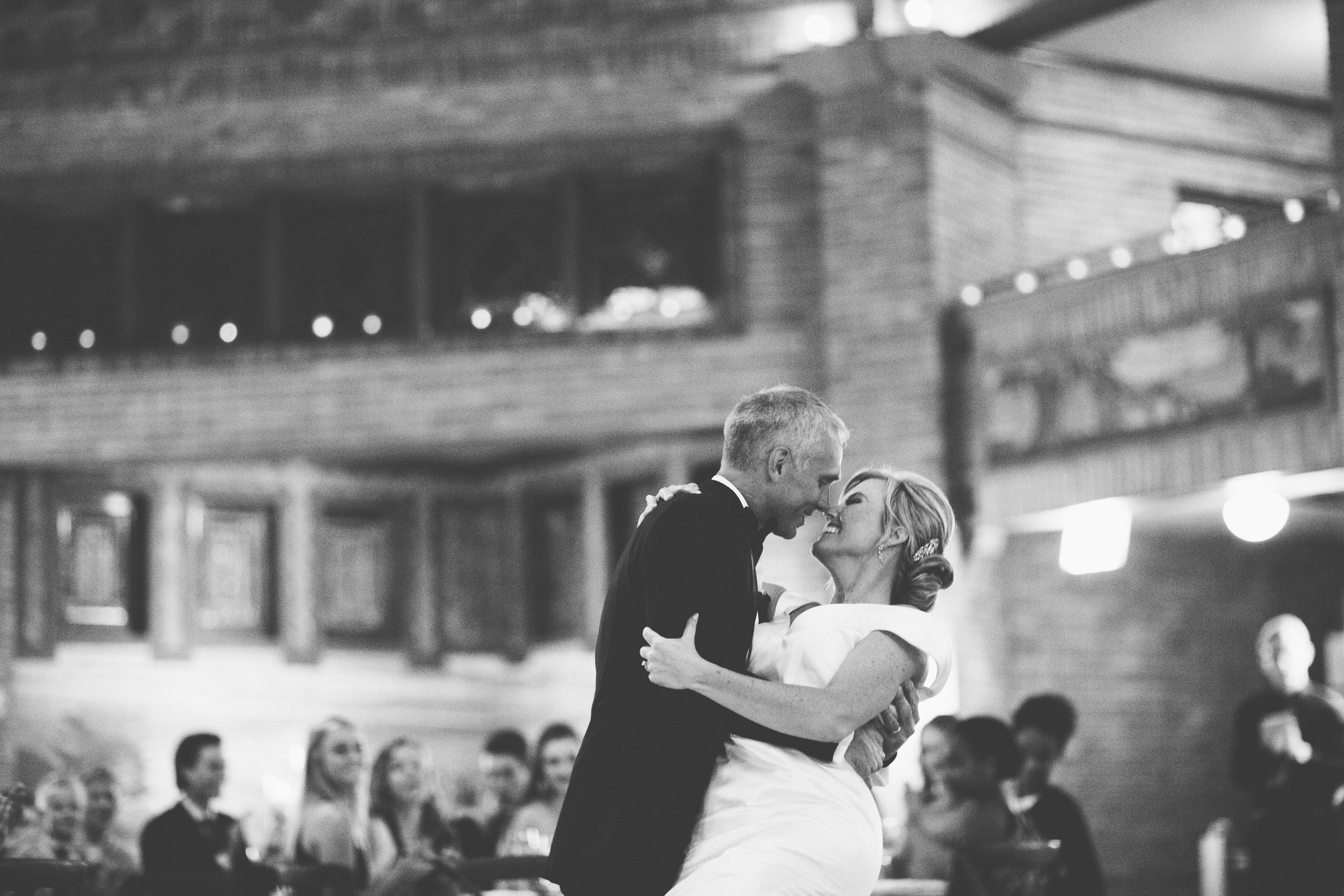 Couple doing a dip and smiling during their first dance in Chicago
