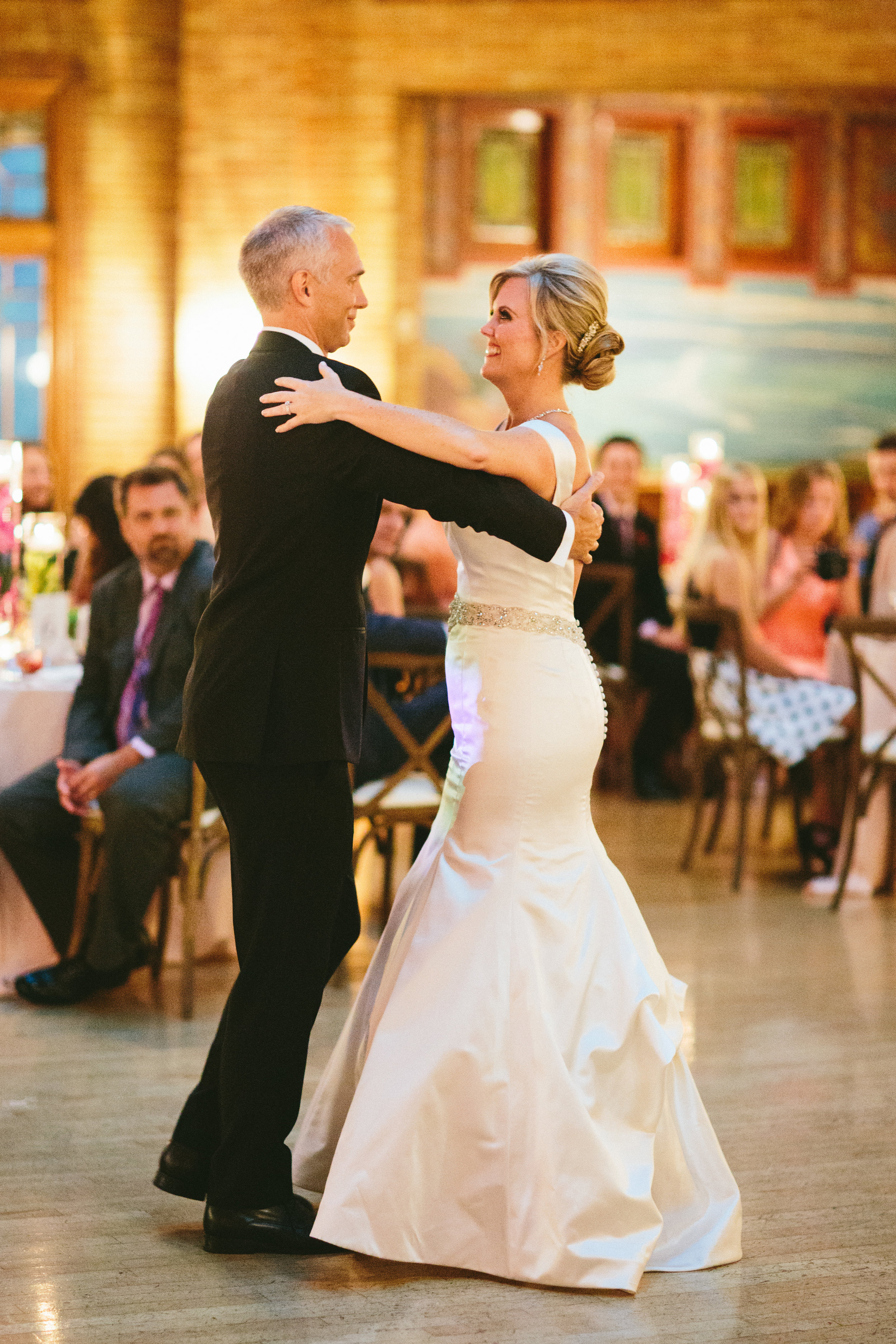 A couple performing their first dance at their wedding.