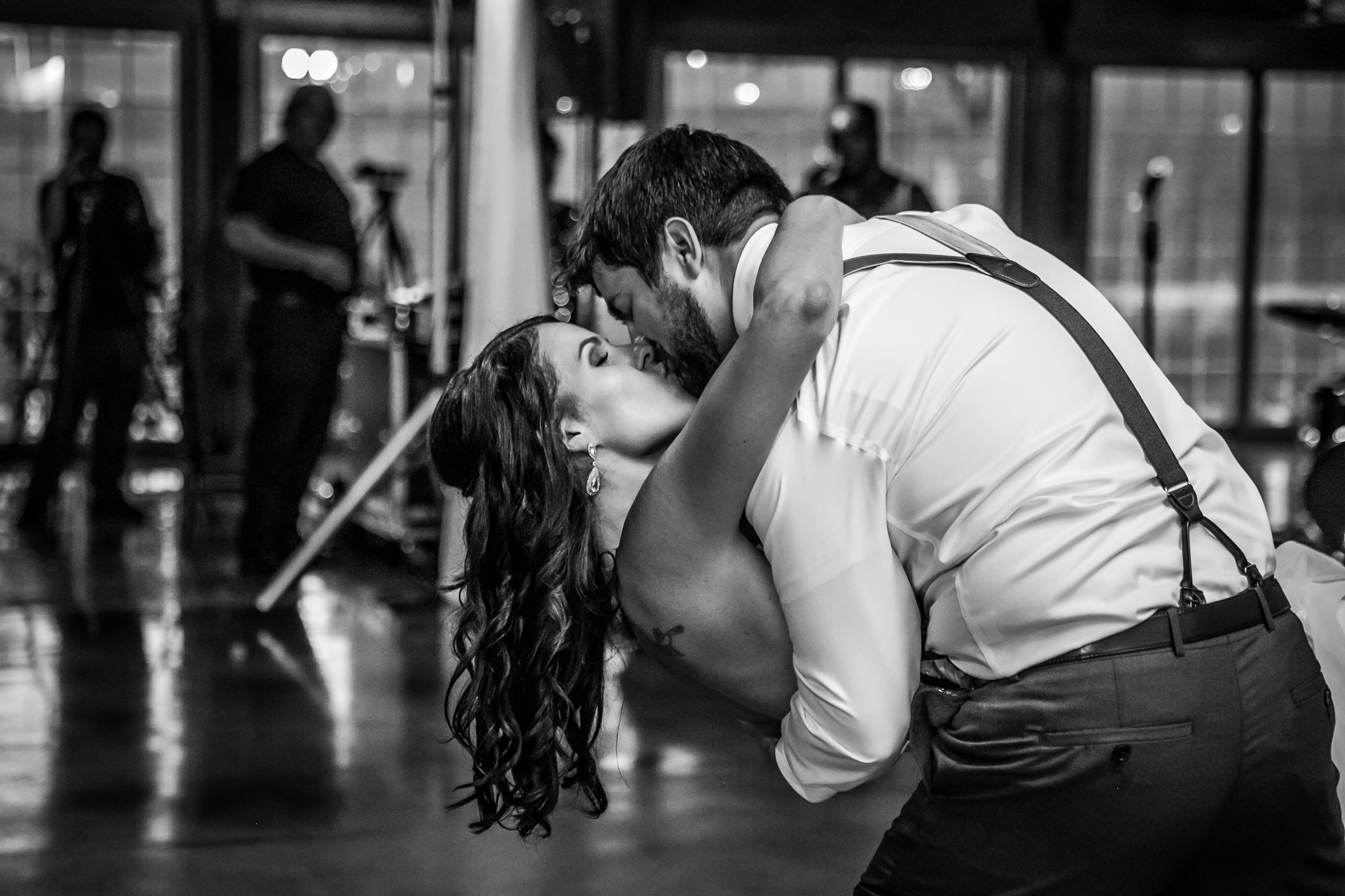 Couple dipping and kissing during their first dance at their wedding.