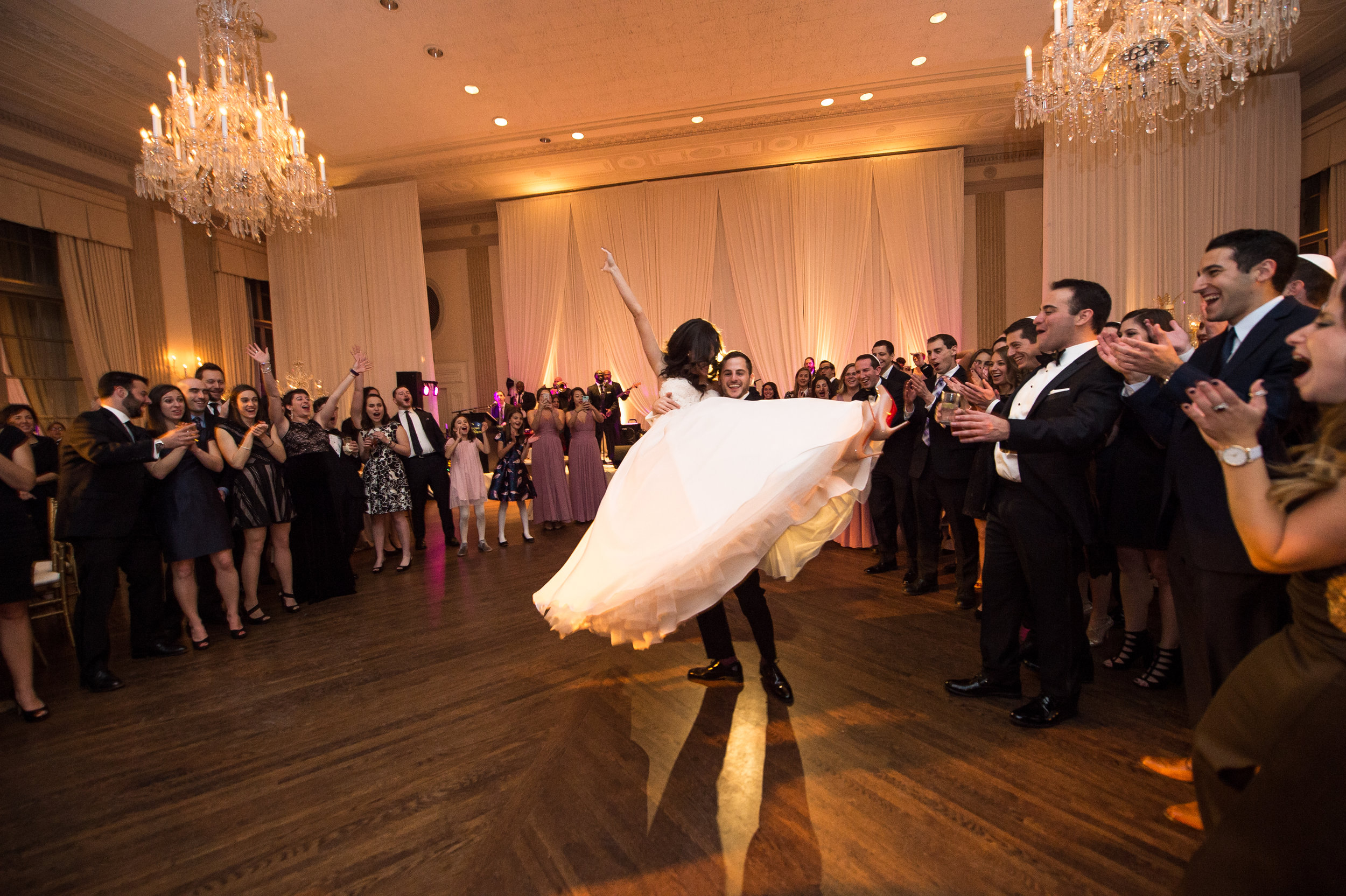 A groom lifting the bride during their first dance