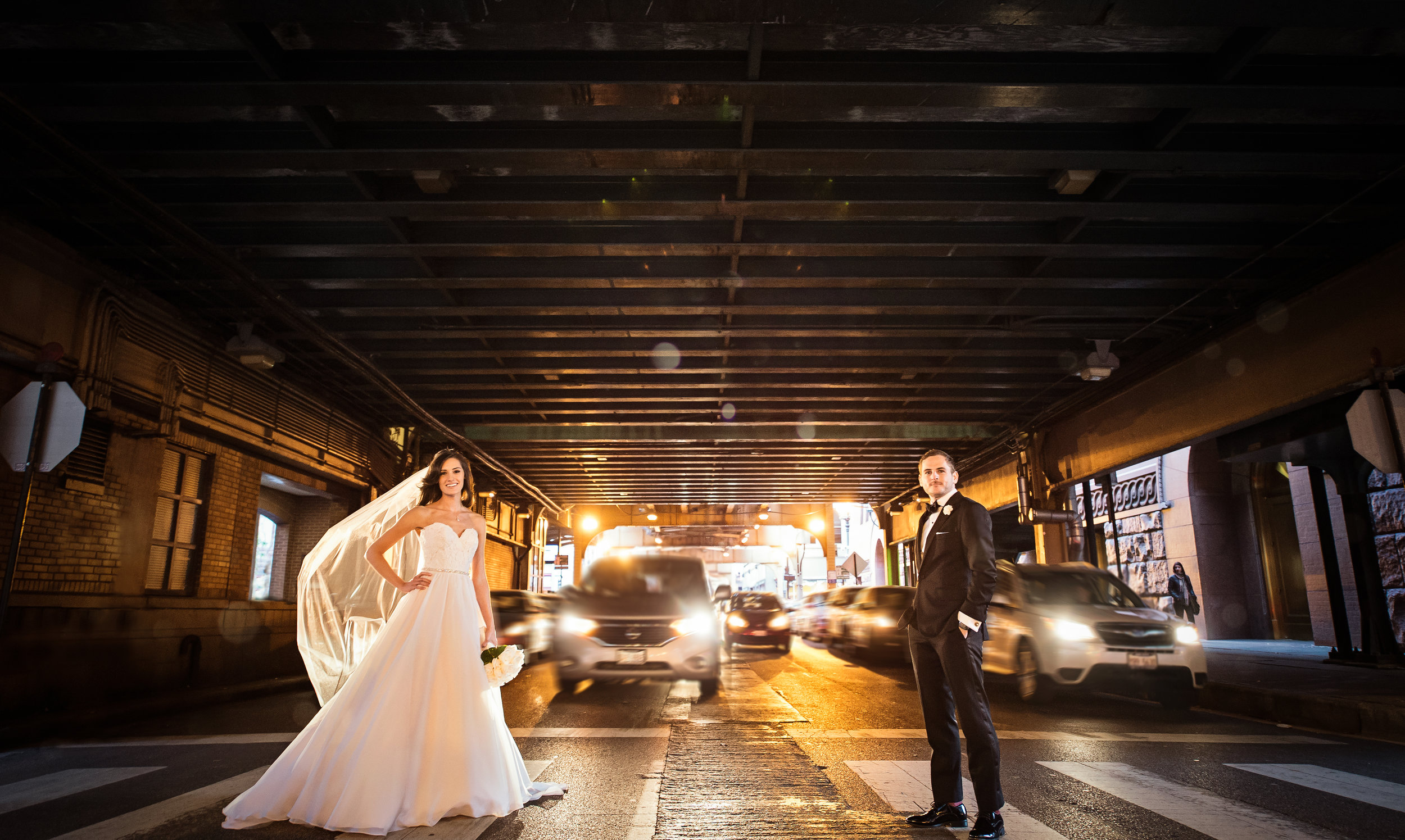Wedding couple posing in Chicago traffic