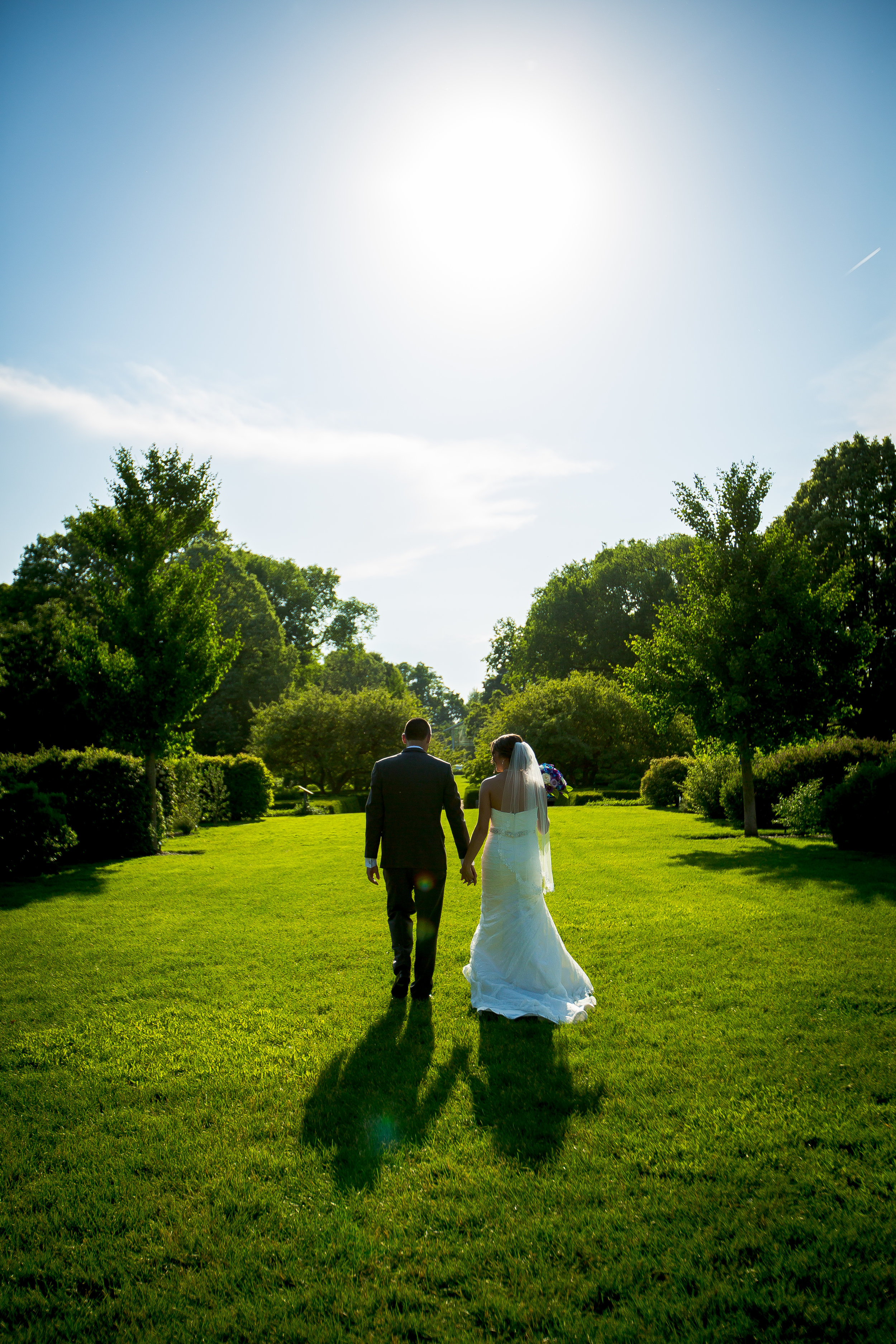 Bride & groom walking into the sunset