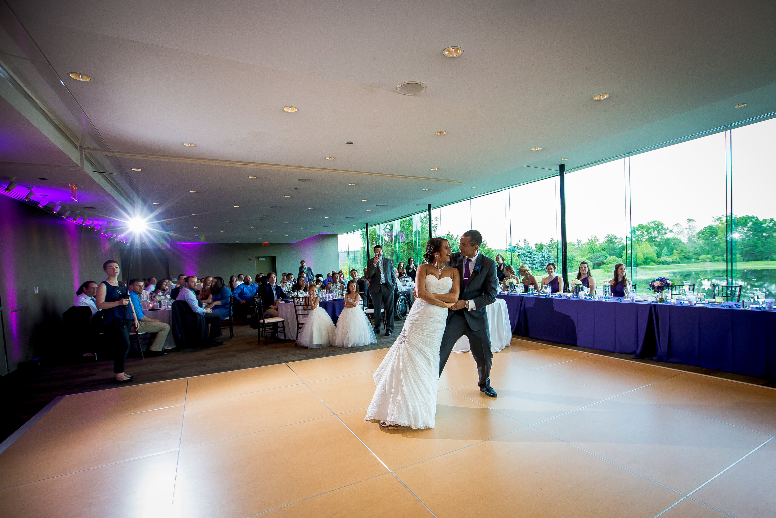 Bride and groom doing a dip move during their first dance