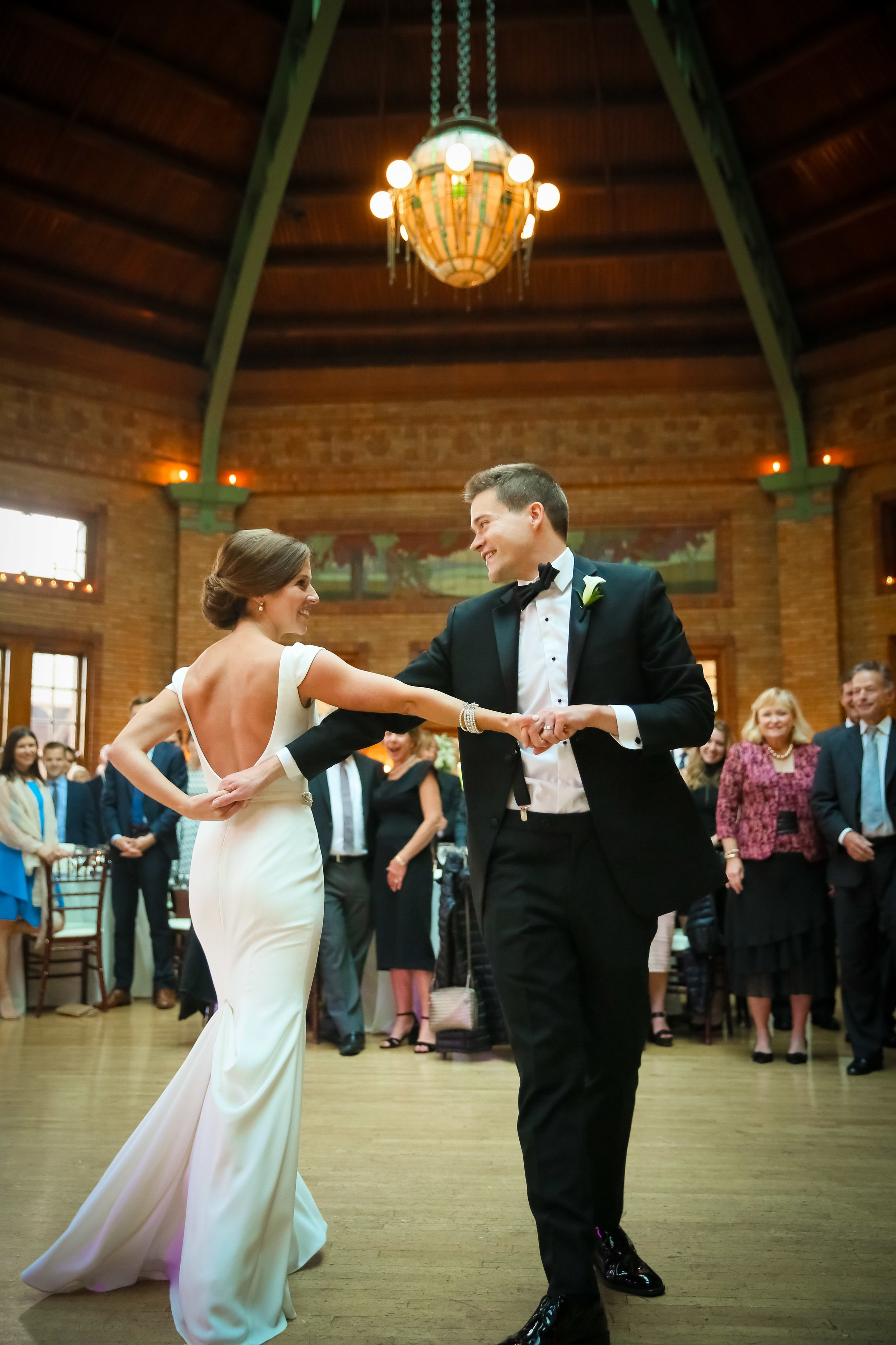 Bride and groom doing a fancy dance move during their first dance.