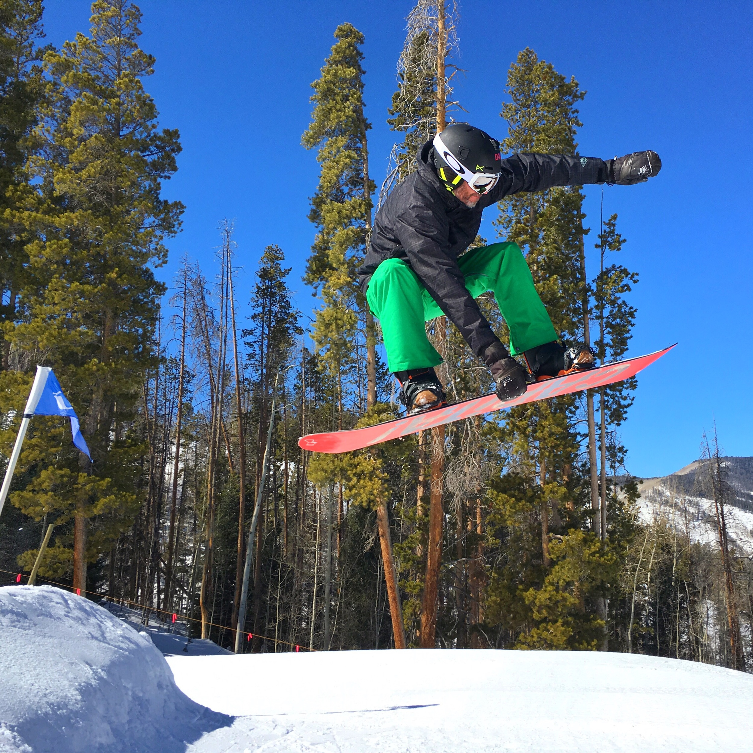 mick doing a snowboard jump