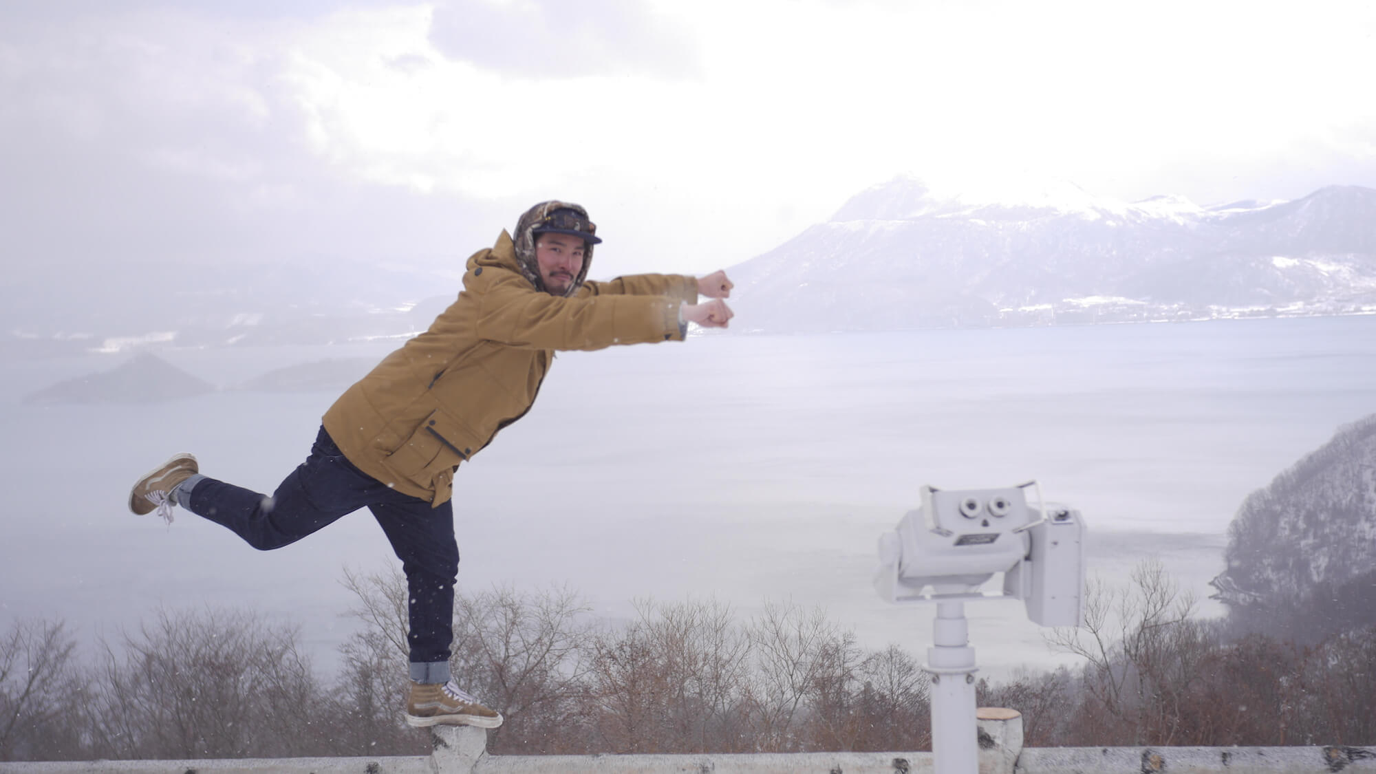A RECENT AND RARE PHOTO (HE'S USUALLY BEHIND THE CAMERA) TAKEN OF JAMES AT LAKE TOYA IN HOKKAIDO, JAPAN.