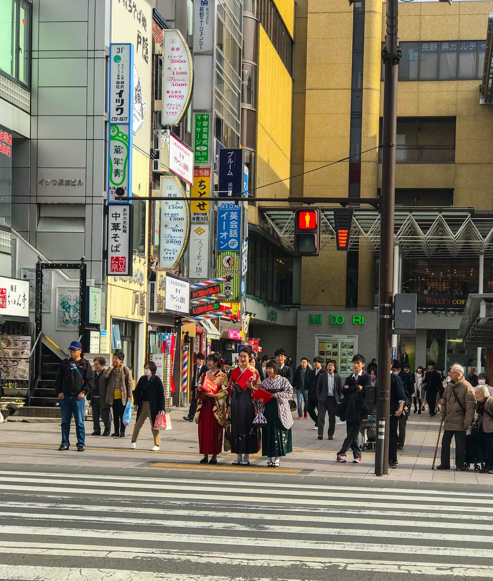 THE BUSTLING NAGANO - TRADITION MIXED WITH MODERN DAY. THE GUY IN THE BACK IS VERY TIRED!