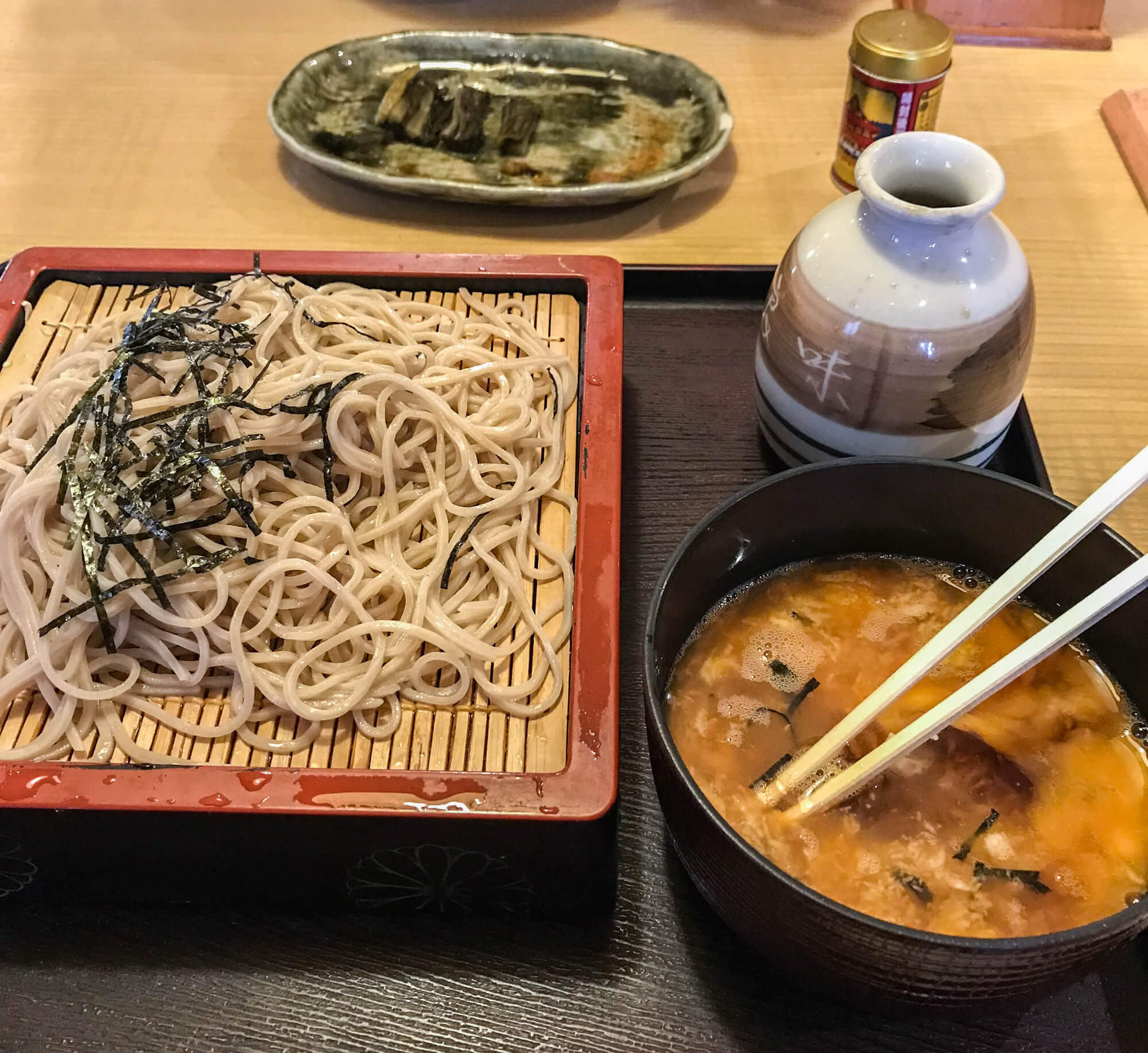 A TYPICAL LUNCHTIME MEAL - SOBA NOODLES, WITH SOME FAMOUS NOZAWANA IN THE BACKGROUND