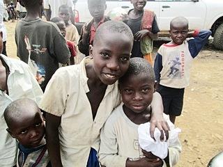 Several children posing for Paul Freedman in Goma.