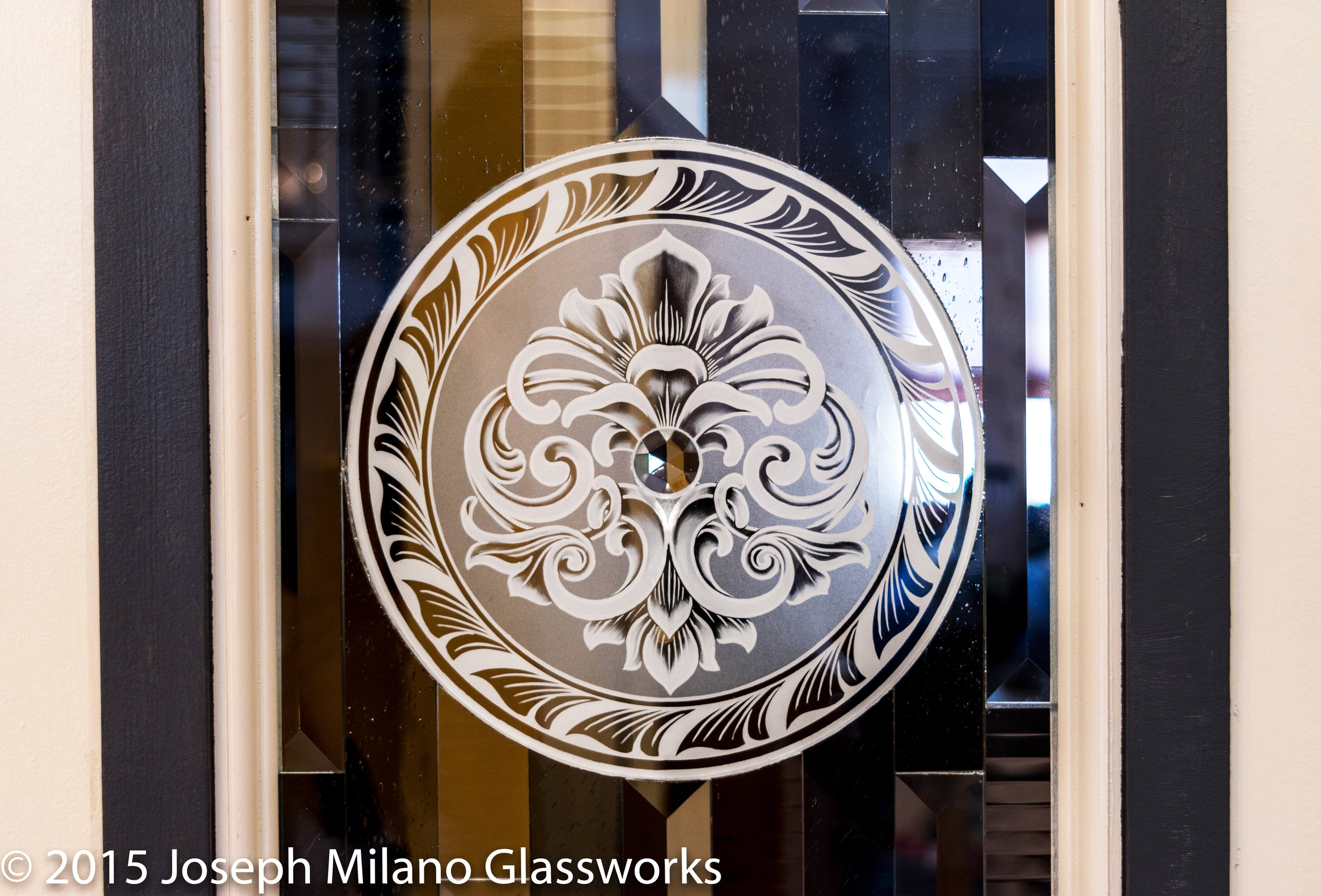 Titanium etched glass medallion
