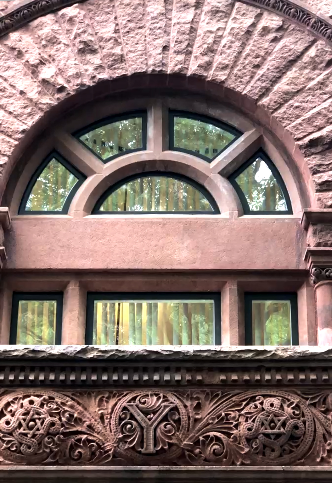 Detail of carved brownstone over the main entrance of 15 Hillhouse Avenue