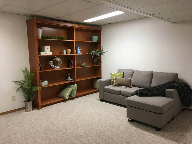 This seemingly small room looks much bigger and more inviting with furnishings, and highlighting the built in bookcase.