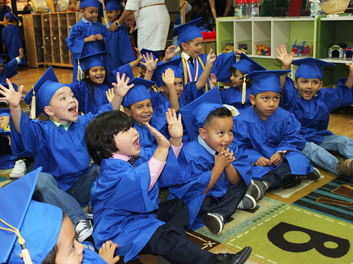 Our preschool students getting ready for graduation and singing some songs!