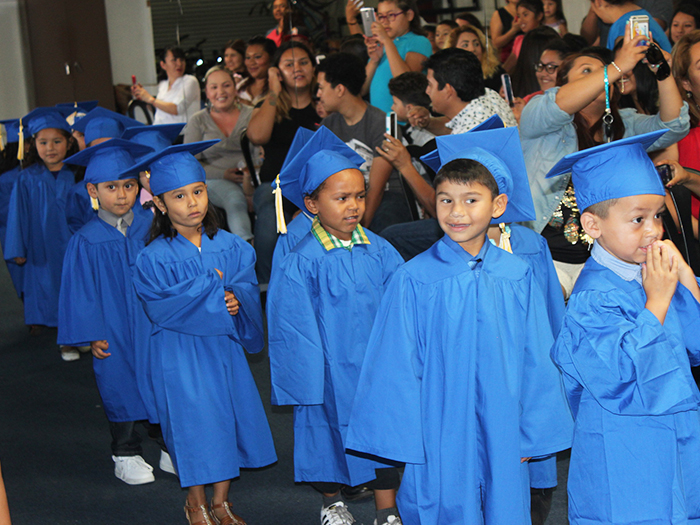 Our parents could barely contain their excitement as the KidWorks Preschool Class of 2016 entered the auditorium.