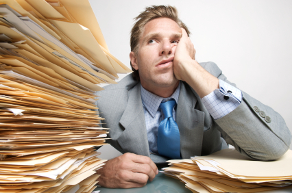 Back-office-stack-of-paperwork.jpg