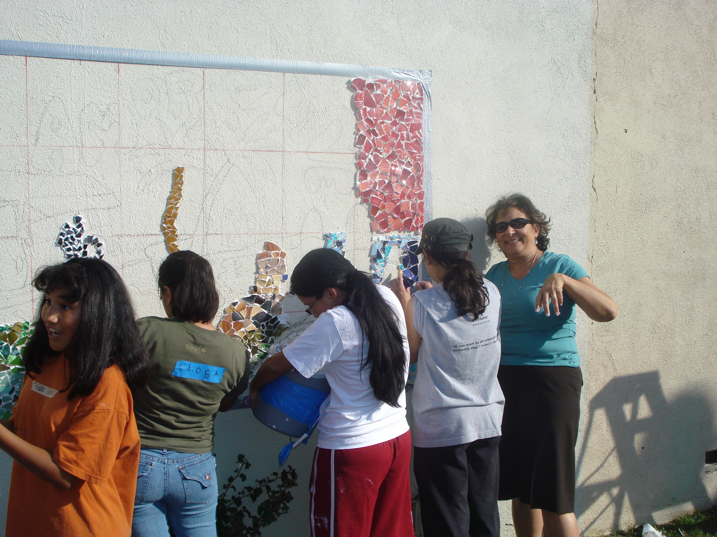 CLOSA students design the mural in 2006