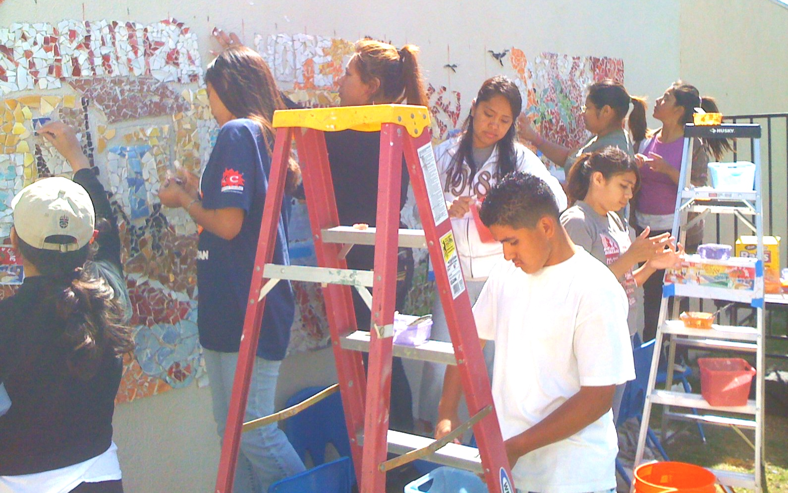 Creating the mural using glass front the neighborhood