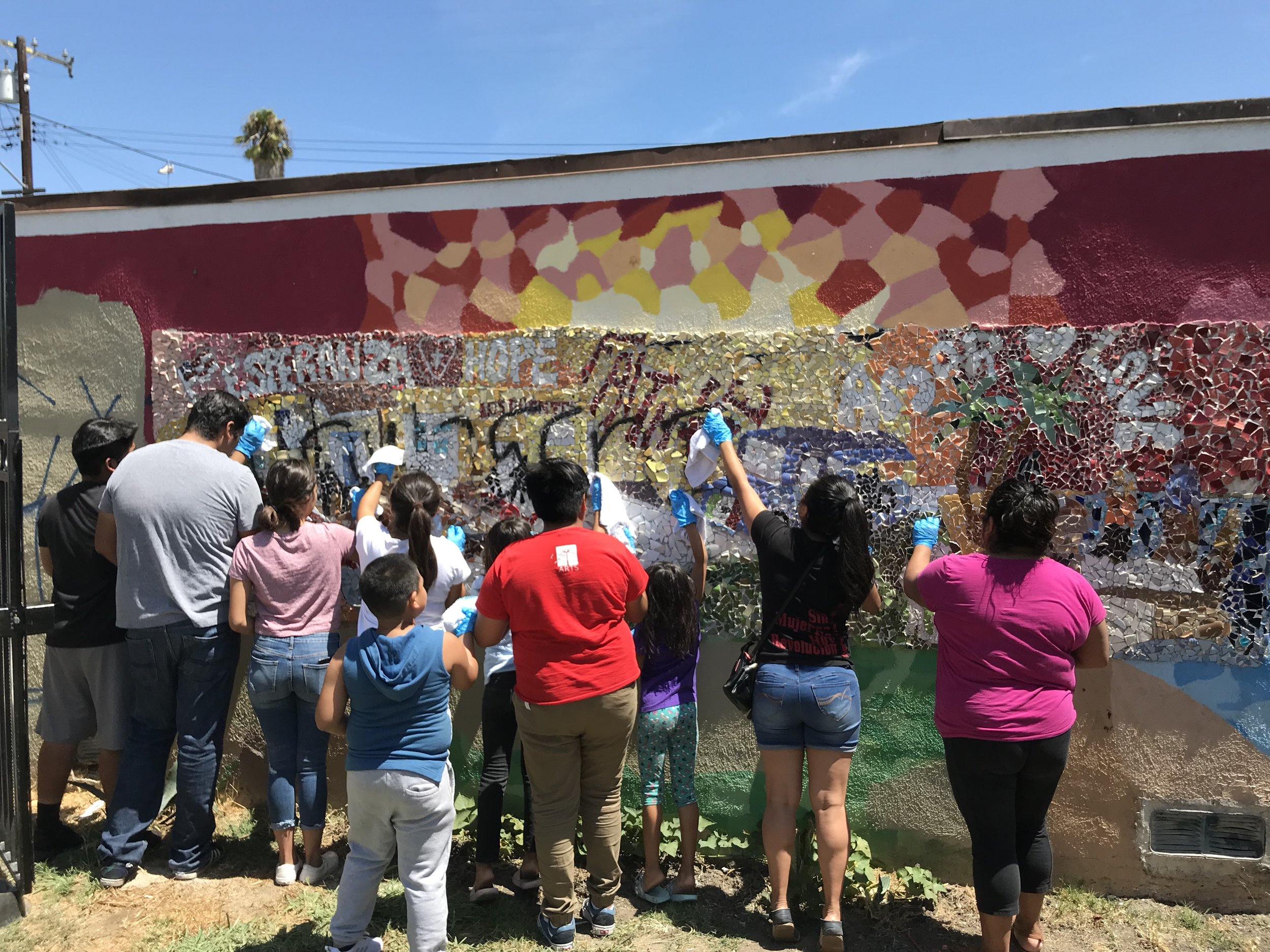 KidWorks youth work to remove graffiti