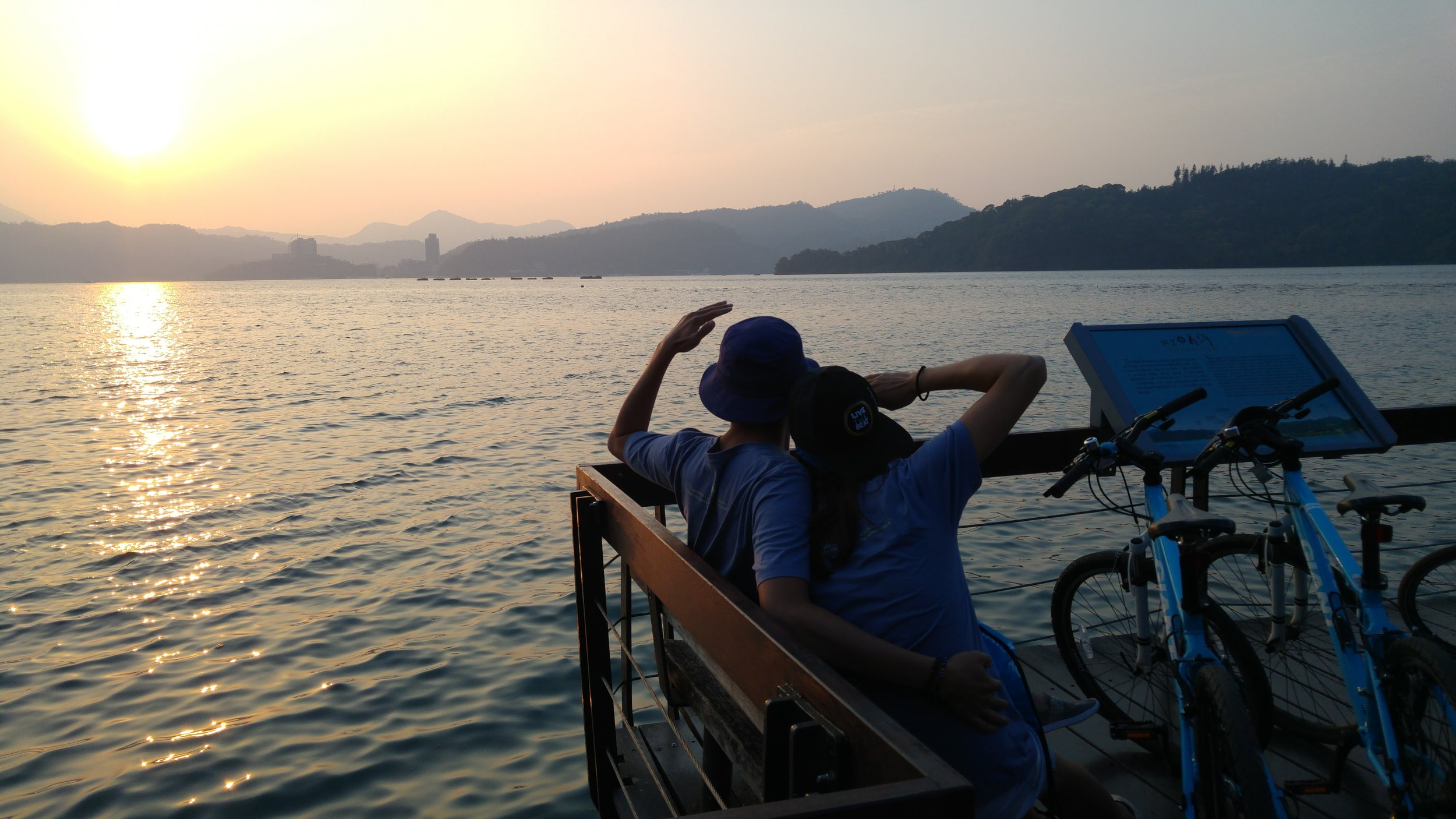Romantic sunset view of a biking couple in Sun Moon Lake