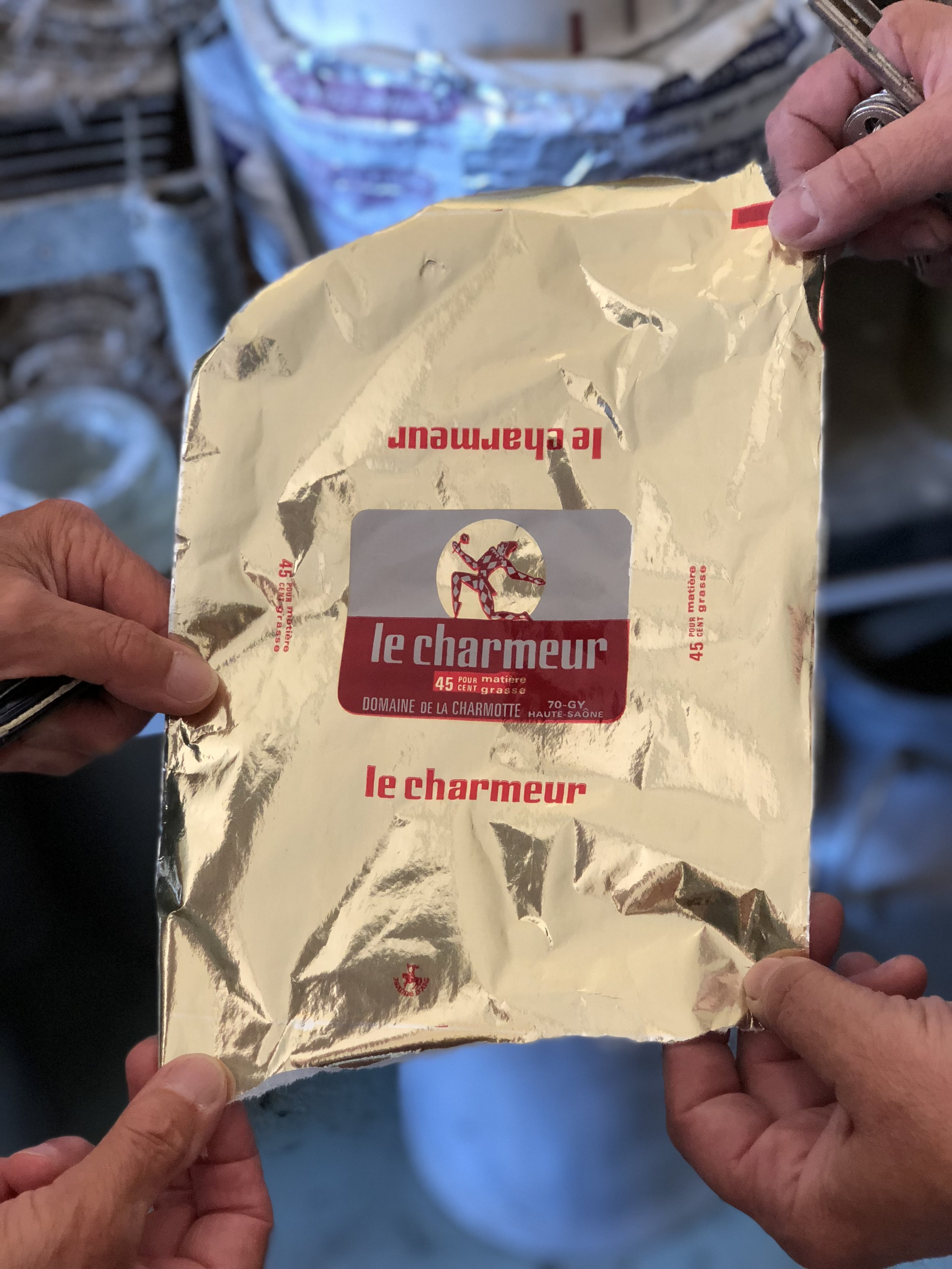 a souvenir torn from the last roll of gold paper used to package the cheese