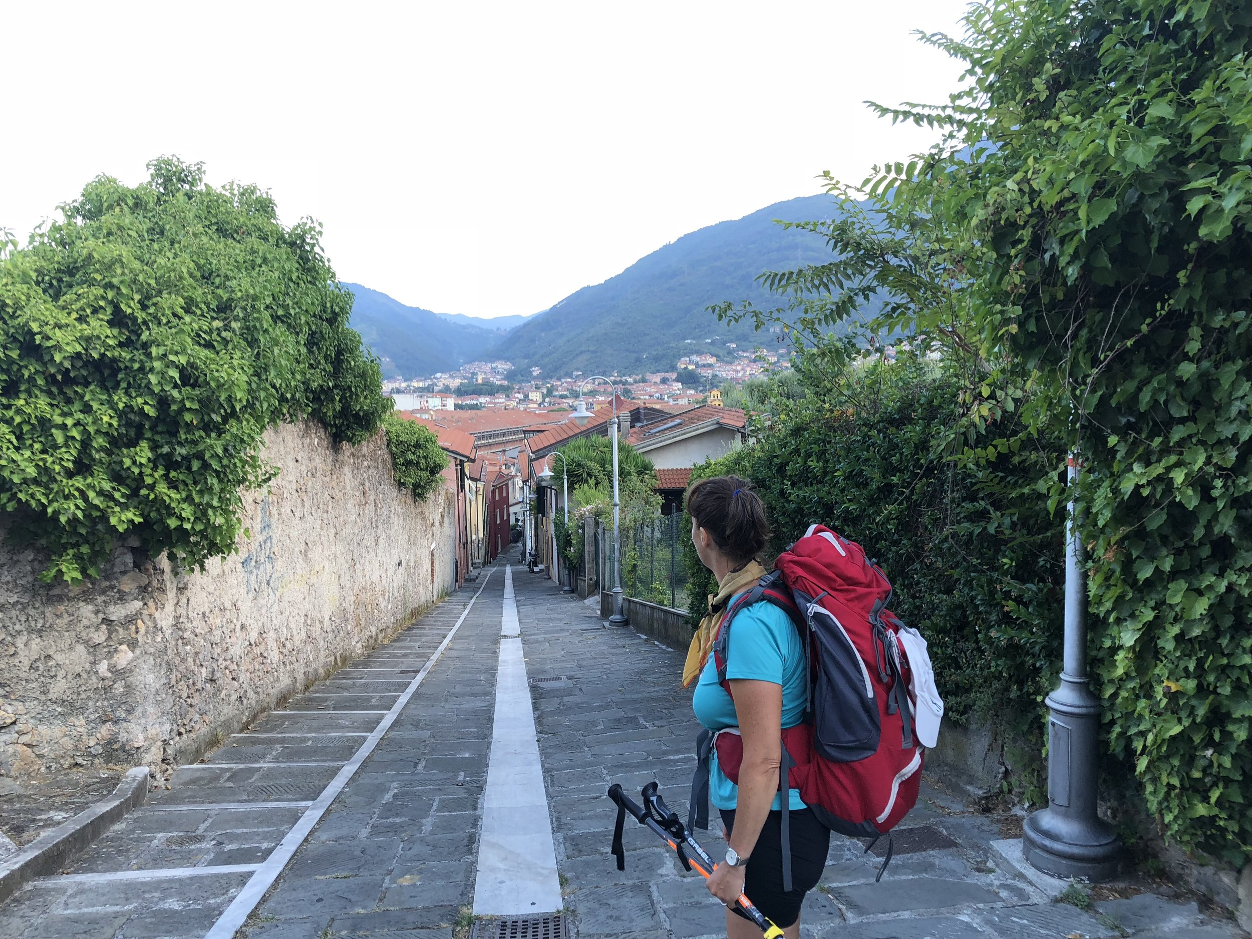 The day was hot and the path was climbing and full of surprises.    A view of the Mediterranean Sea and the first town of the Cinque Terre.