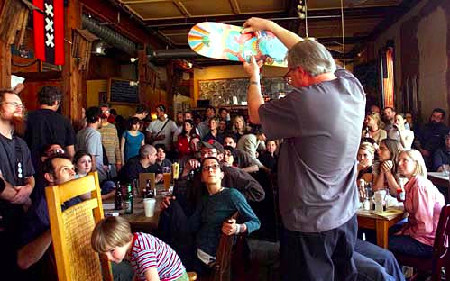 Donald Keyes auctions a skateboard at the Globe. Sunday, March 21, 2004 photo credit: Online Athens
