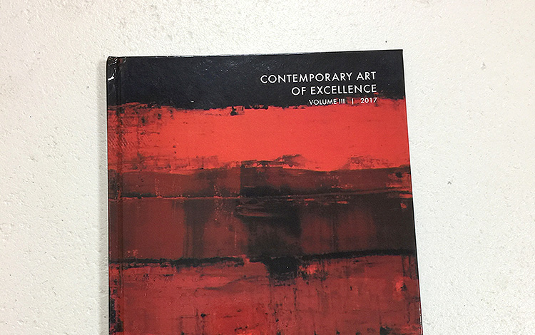 Front view of the art book 'Book of Excellence Vol III', published the Global Art Agency. Dutch artist Mr. Upside / Michiel Nagtegaal is featured in the publication with a double page and four images of the abstract paintings