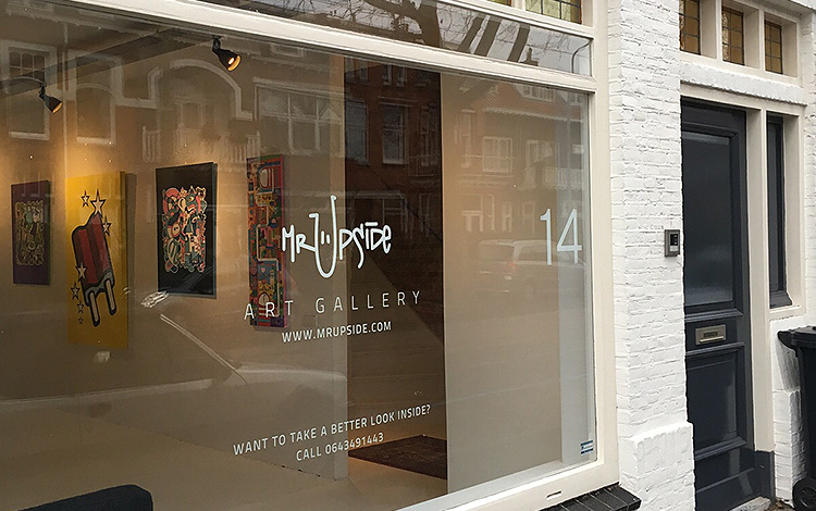 View of the shopping window of the Mr. Upside Gallery in Voorburg, the Netherlands