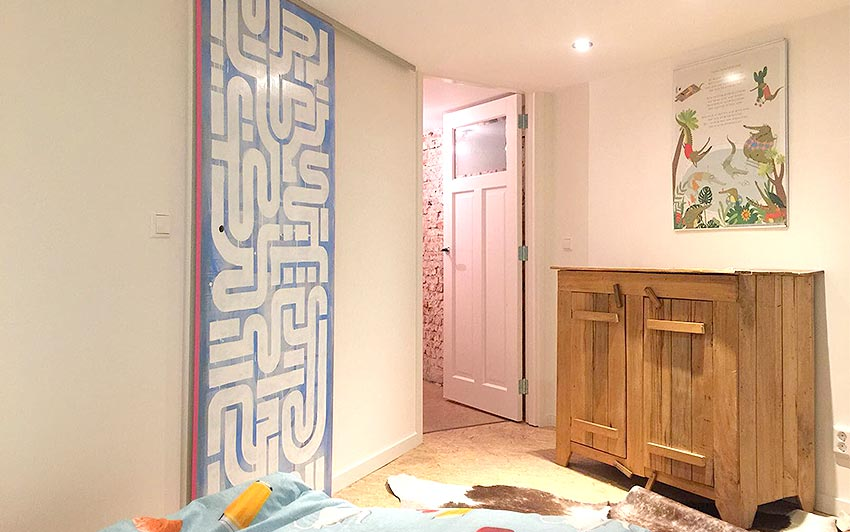 PICTURE 2 of 12 - One of The finished sliding doors with a blue background and pink side hanging in one of the bedrooms available in the airbnb location in voorburg, the netherlands