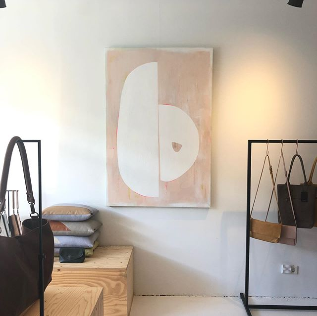 "Ah! Found a nice spot for this beauty. Swipe through the pictures and video to see the lesser alternative. The bags, btw are handmade leather bags by @studiojanettevantol and this is her shop in Voorburg :) . The painting is called 'Contiguity nr. 3' and still for sale at my webshop for € 1440. . It measures 100x150x4,5cm (39""x59""x1.7"") and is made from acrylic on canvas. . In this new Contiquity collection of paintings, I am inspired by how two entities (depicted by shapes) are drawn to eachother but still remain separate. It is the tension of a very delicate and tender touch that strikes me. The interference shapes that sometimes touch and sometimes stay close but don't touch. . Interested in acquiring this artwork? Please send me a DM or e-mail (link in bio). . . . #art #artist #contiguity #contemporary #contemporaryArt #minimalart #minimal #abstract #pink #white #interior #interiordesign #interiordesigner #gallery #gallerywall #kunst #kunstenaar #Voorburg #Denhaag #wallart #painting #webshop #bags #bag #leather"