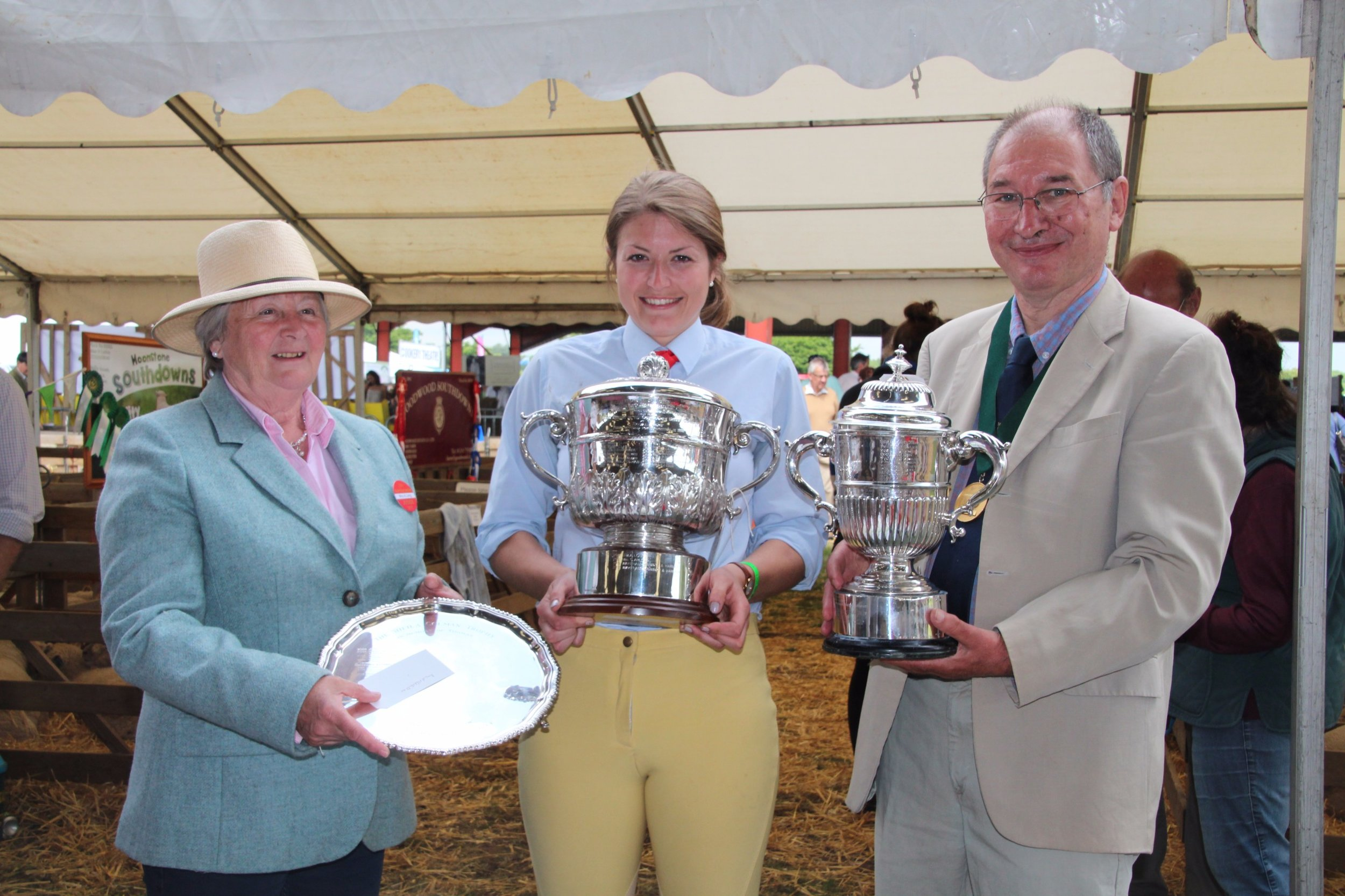 Winning Breeder Ms Jessica Middleditch with the championship trophies