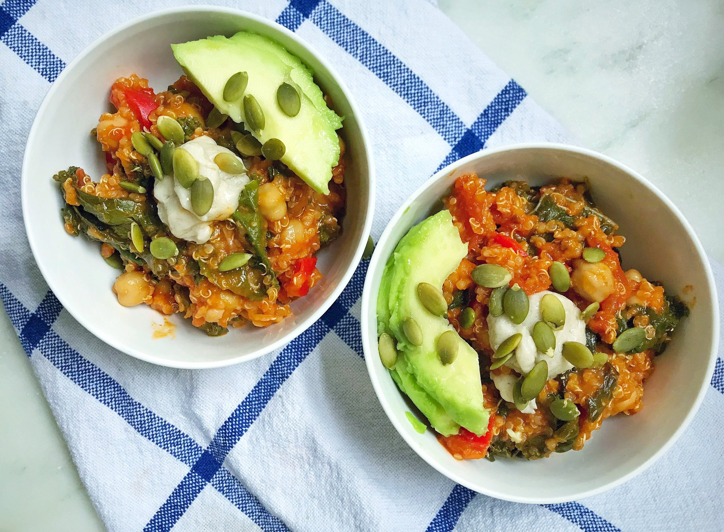 All the protein and good fats here: pumpkin/quinoa/chickpea chili topped with vegan mozz, avocado and pepitas!