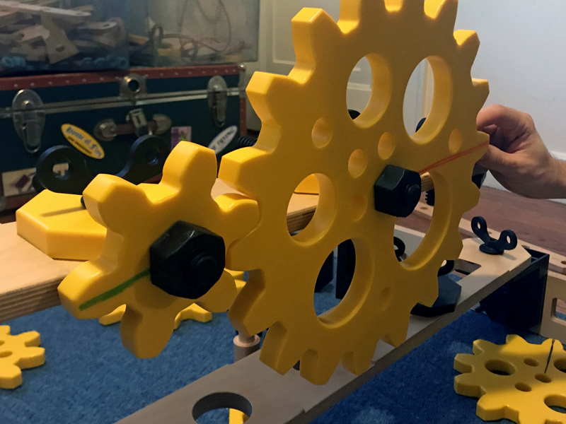 Different size gears on a vertical plane.