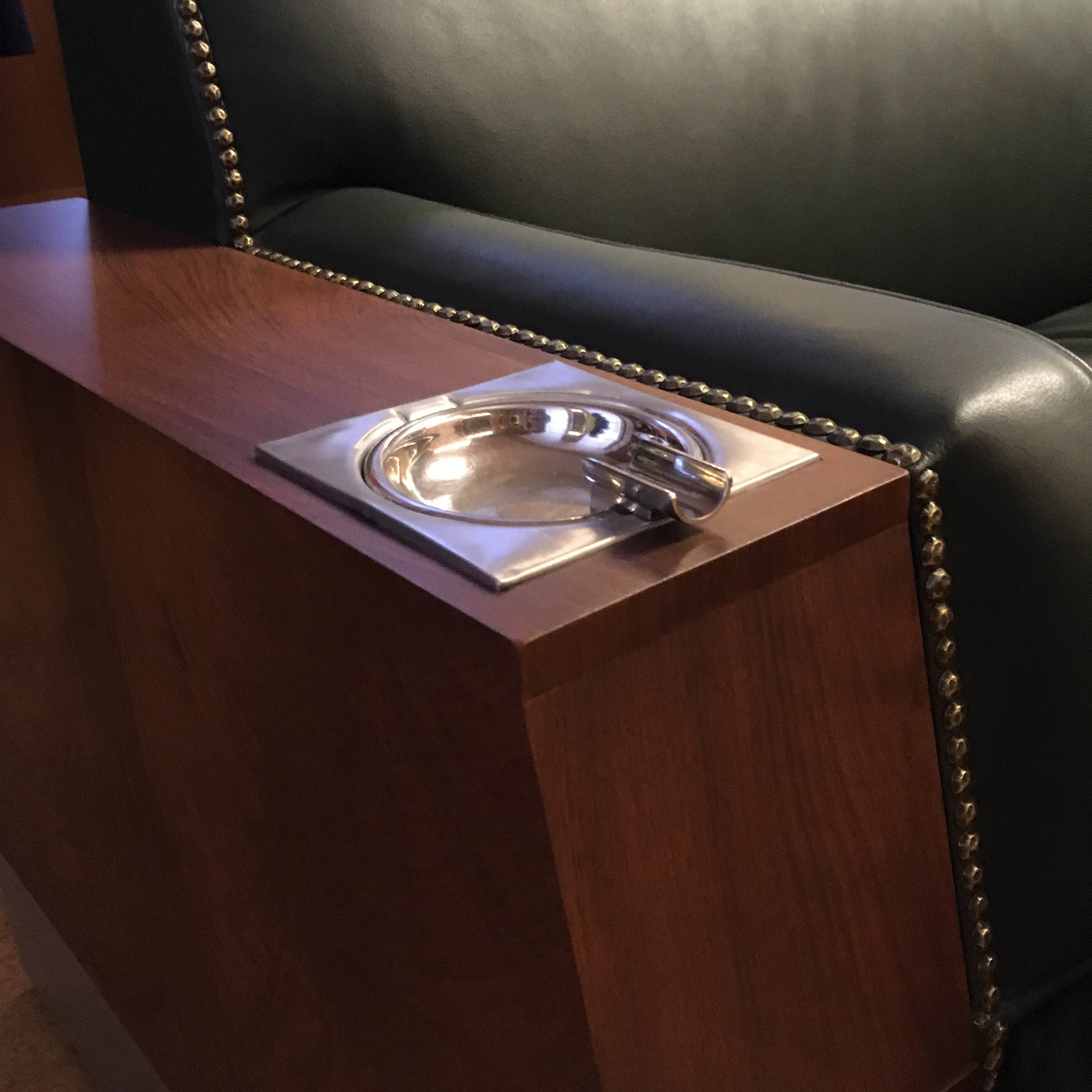 A detail that speaks to the times.  In the board room outside the President's office, these chairs boast a built-in cigarette holder and ash tray that flips and dumps the ashes into a cavity beneath.