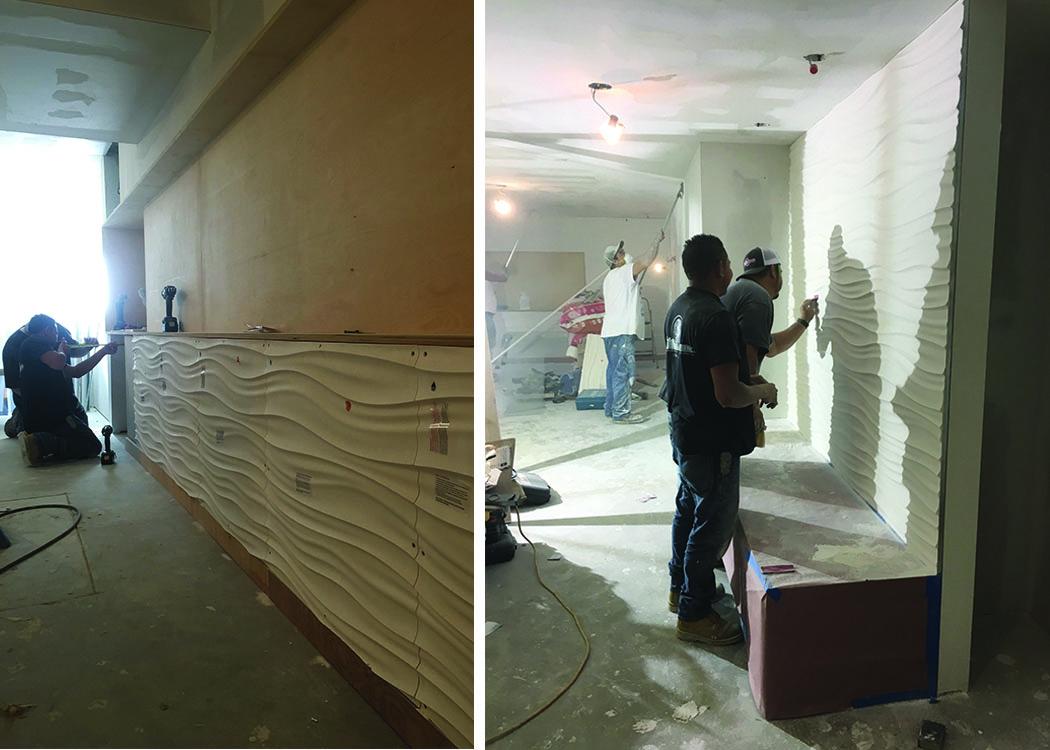 Construction crew installing the Modular Arts panels.