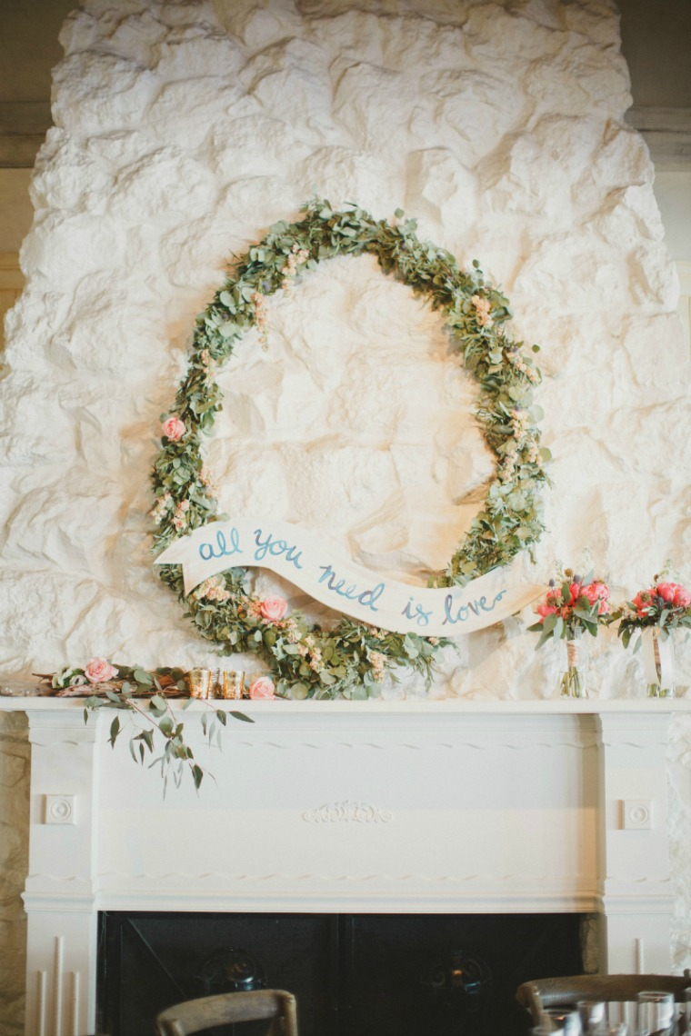 My husband and I made this banner for our wedding. It was one of our favorite focal points and was just perfect for the fireplace mantle!  FH Weddings  hit it out of the park with these florals and  Ashton Events  brought it all home with the styling. So much magic to be had. The beautiful image is courtesy of  By The Robinsons .